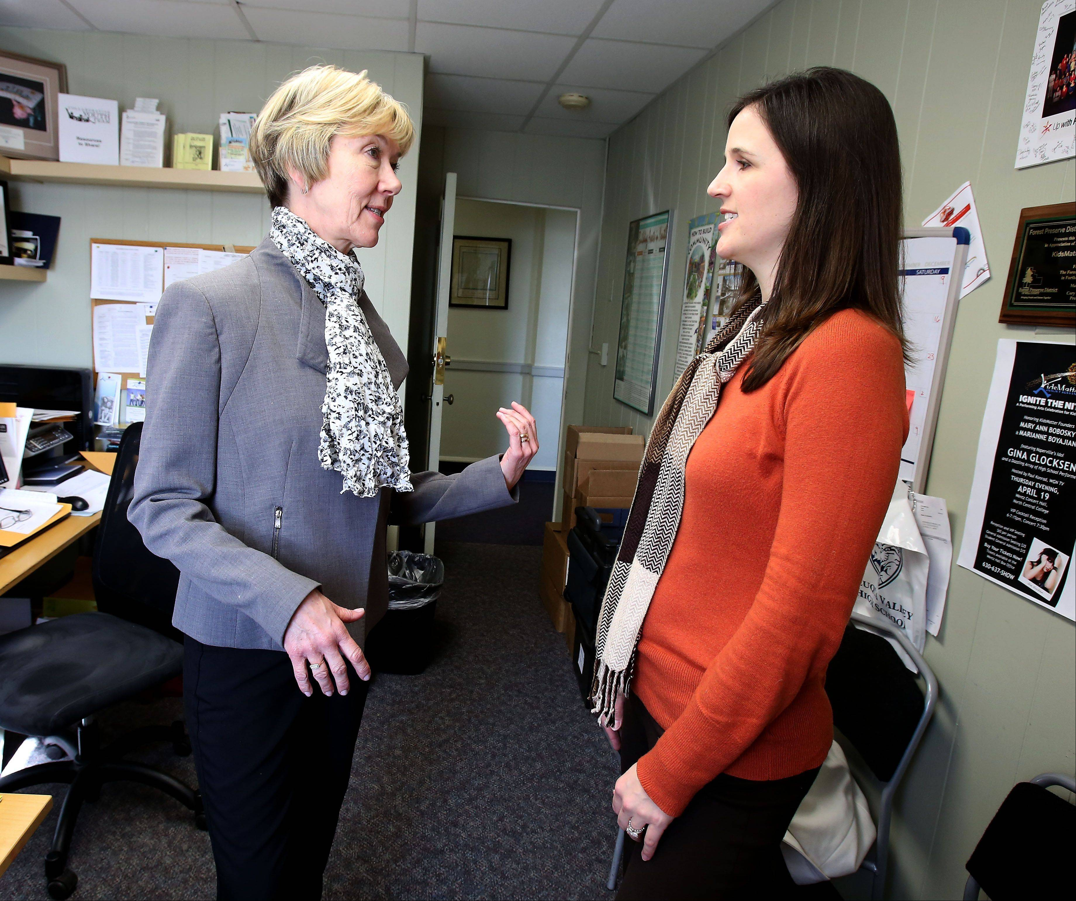 IdaLynn Wenhold, left, executive director of KidsMatter in Naperville, chats with Marion Ruthig, who started I Support Community. Wenhold believes that the video Ruthig's organization will shoot of KidsMatter may be the best way to reach the hearts of donors.