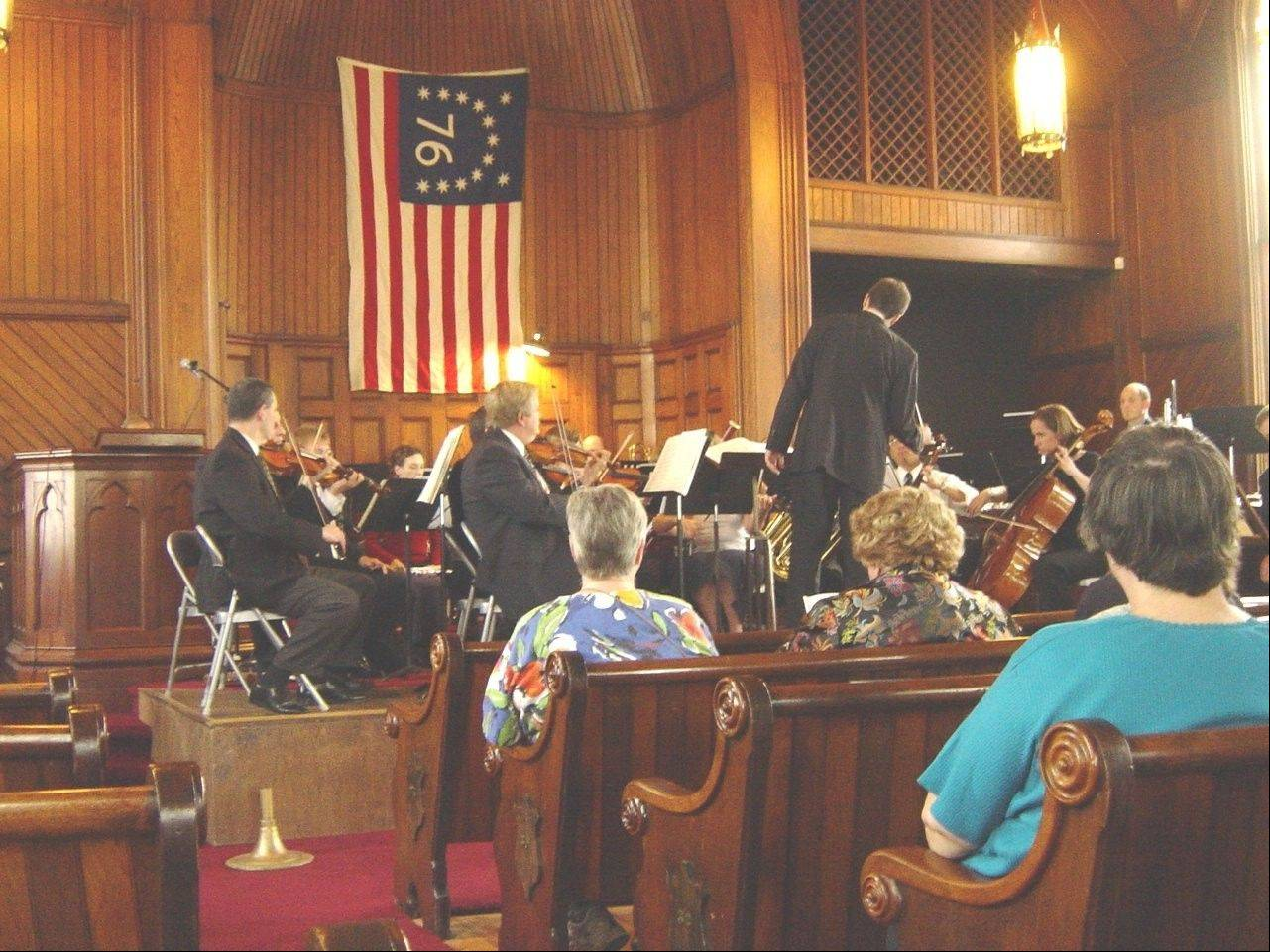 A 22-piece orchestra will perform the 13th annual American Heritage Concert at 3 p.m. Saturday, March 23, as part of the Maple Street Chapel Preservation Society's variety series. Here, the orchestra performs in the chapel at the corner of Main and Maple streets in Lombard.