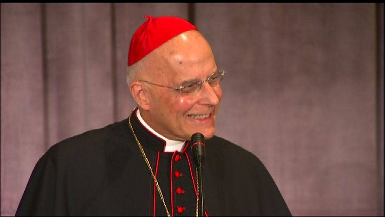 Cardinal Francis George appears Friday night in his first public appearance since being diagnosed with cancer.