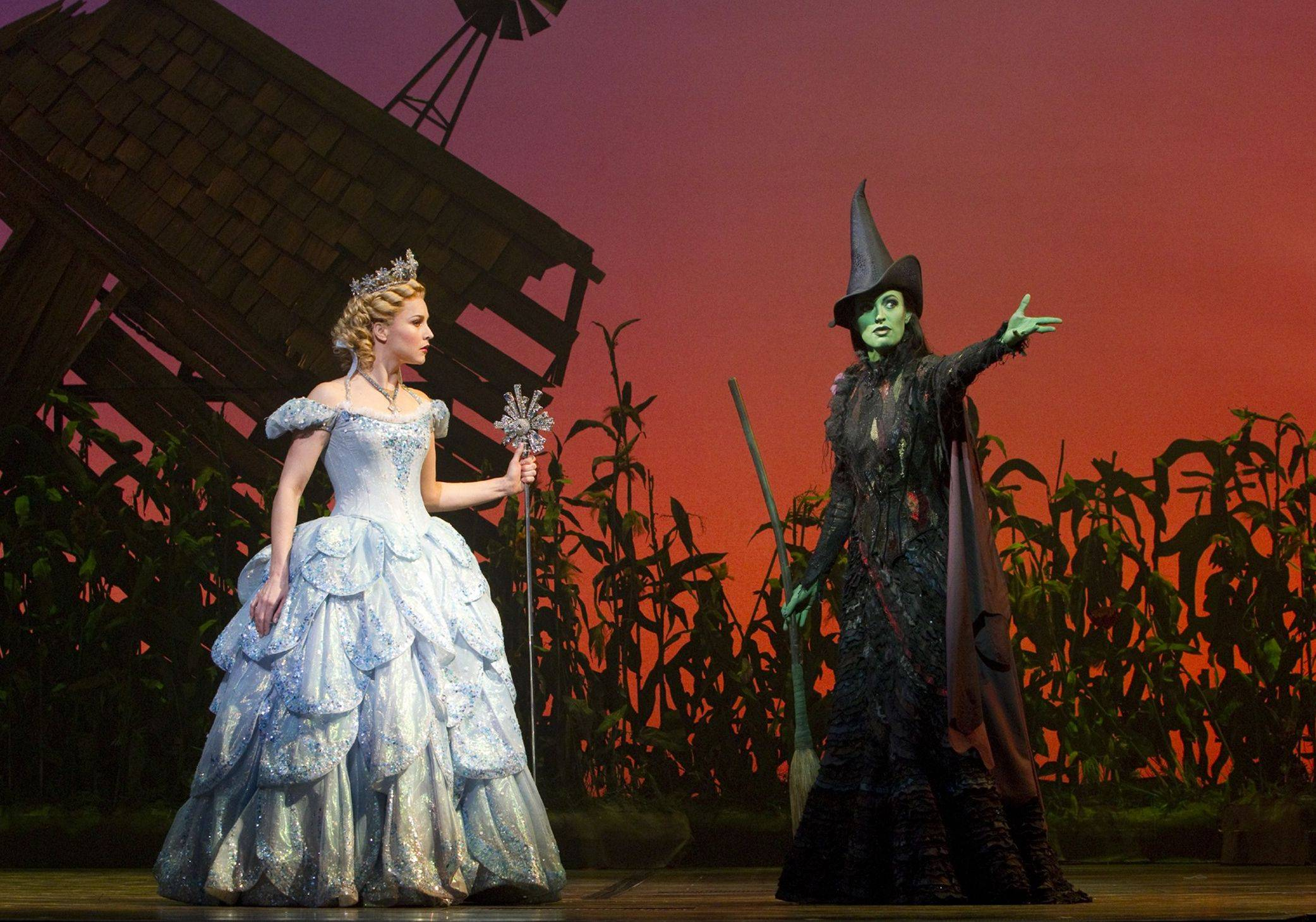 "The Oz witches Glinda (Chandra Lee Schwartz) and Elphaba (Jackie Burns) get into a major spat after Dorothy Gale's house crash lands in Munchkinland, in Broadway in Chicago's 2010 production of the blockbuster musical ""Wicked."" The show returns to Chicago Oct. 30 for a limited run."