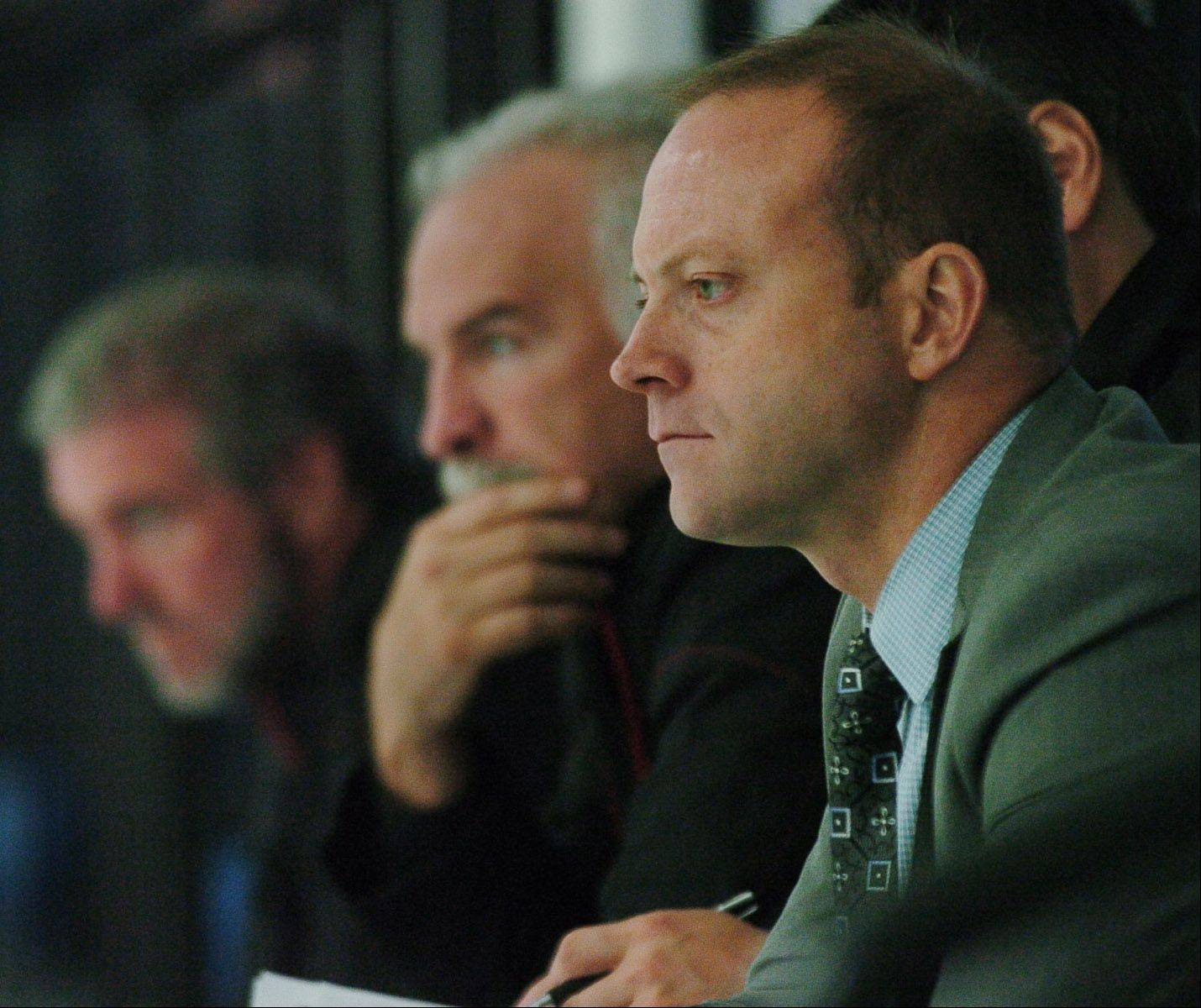Blackhawks general manager Stan Bowman, right, sits with coach Joel Quenneville during a pre-season practice.