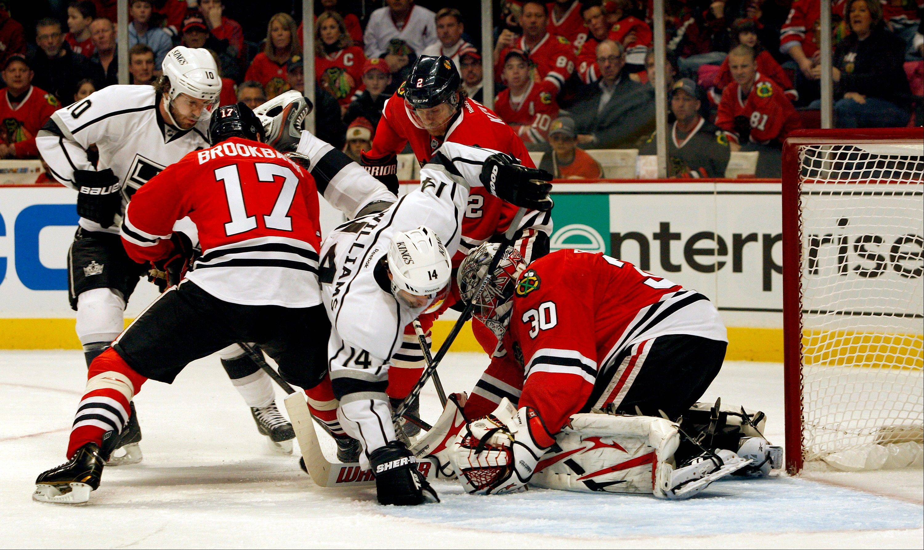 Blackhawks goalie Ray Emery stops the Kings' Justin Williams (14) in front of the goal in the first period of Sunday's victory over Los Angeles at the United Center.