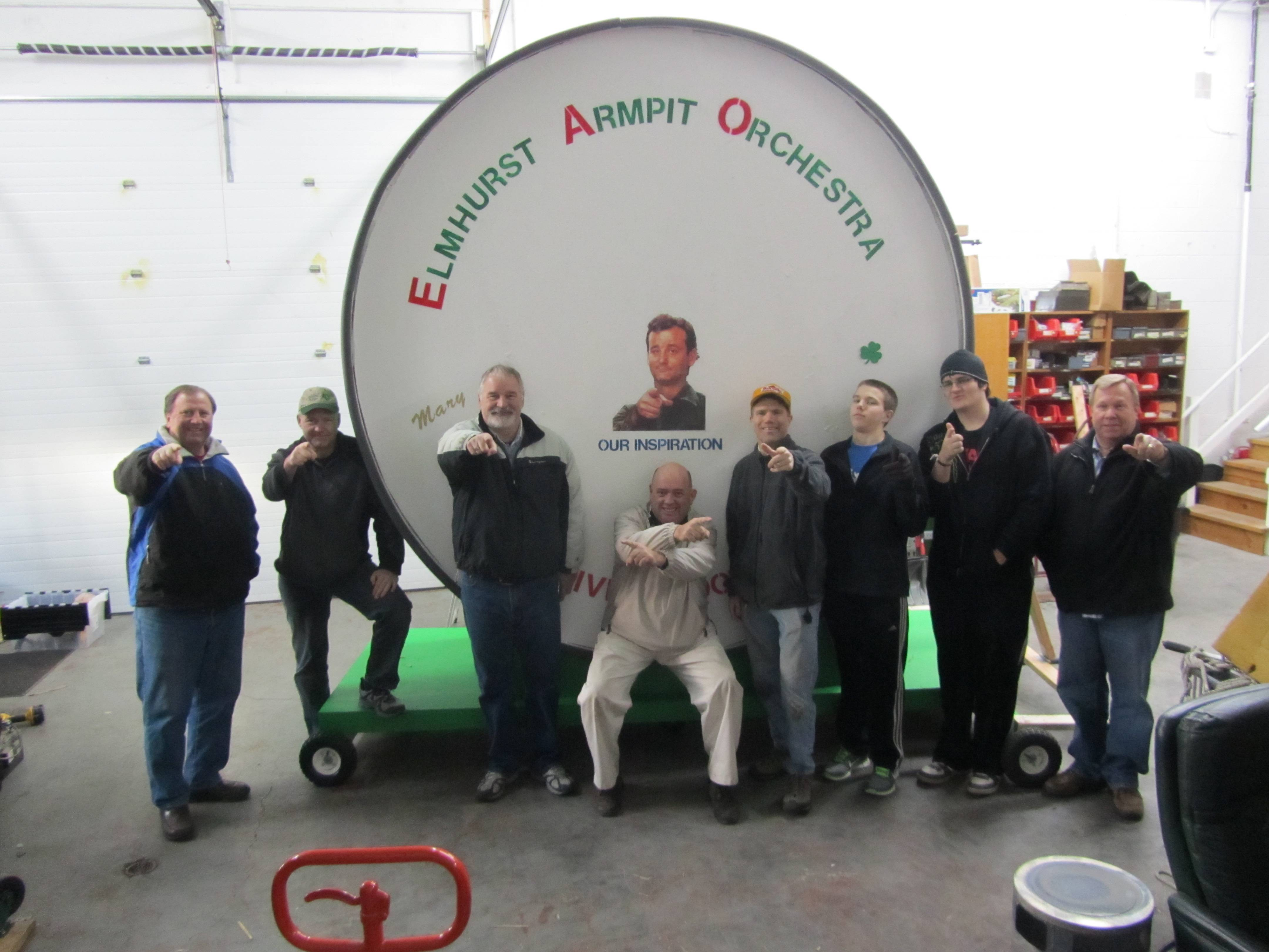 Some men of the Elmhurst Armpit Orchestra with the 'World's Largest Drum'
