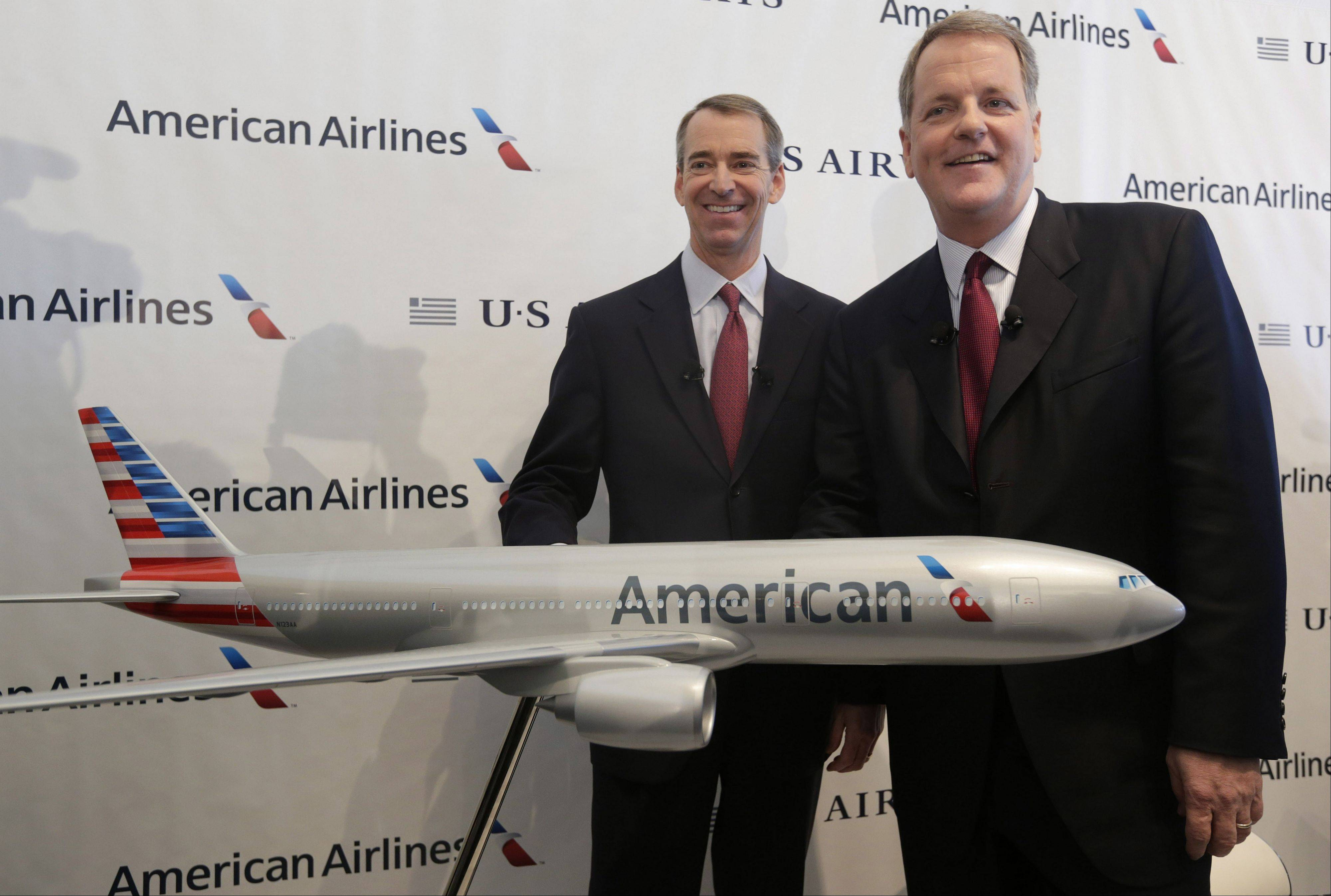 U.S. Airways CEO Doug Parker, right, and American Airlines CEO Tom Horton after a news conference at DFW International Airport.
