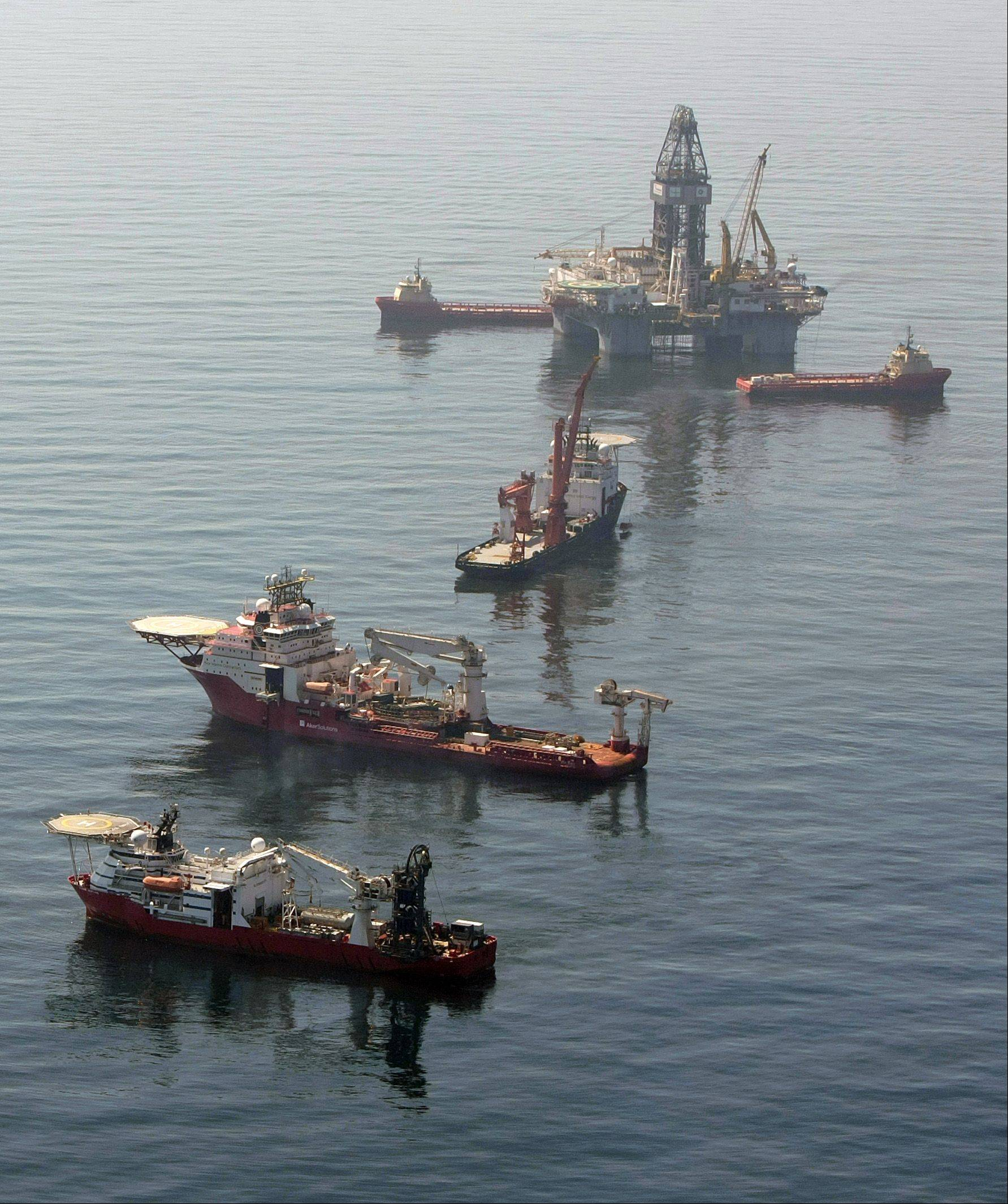 Vessels surround a drilling rig at the site of the Deepwater Horizon in the Gulf of Mexico Thursday, May 6, 2010.