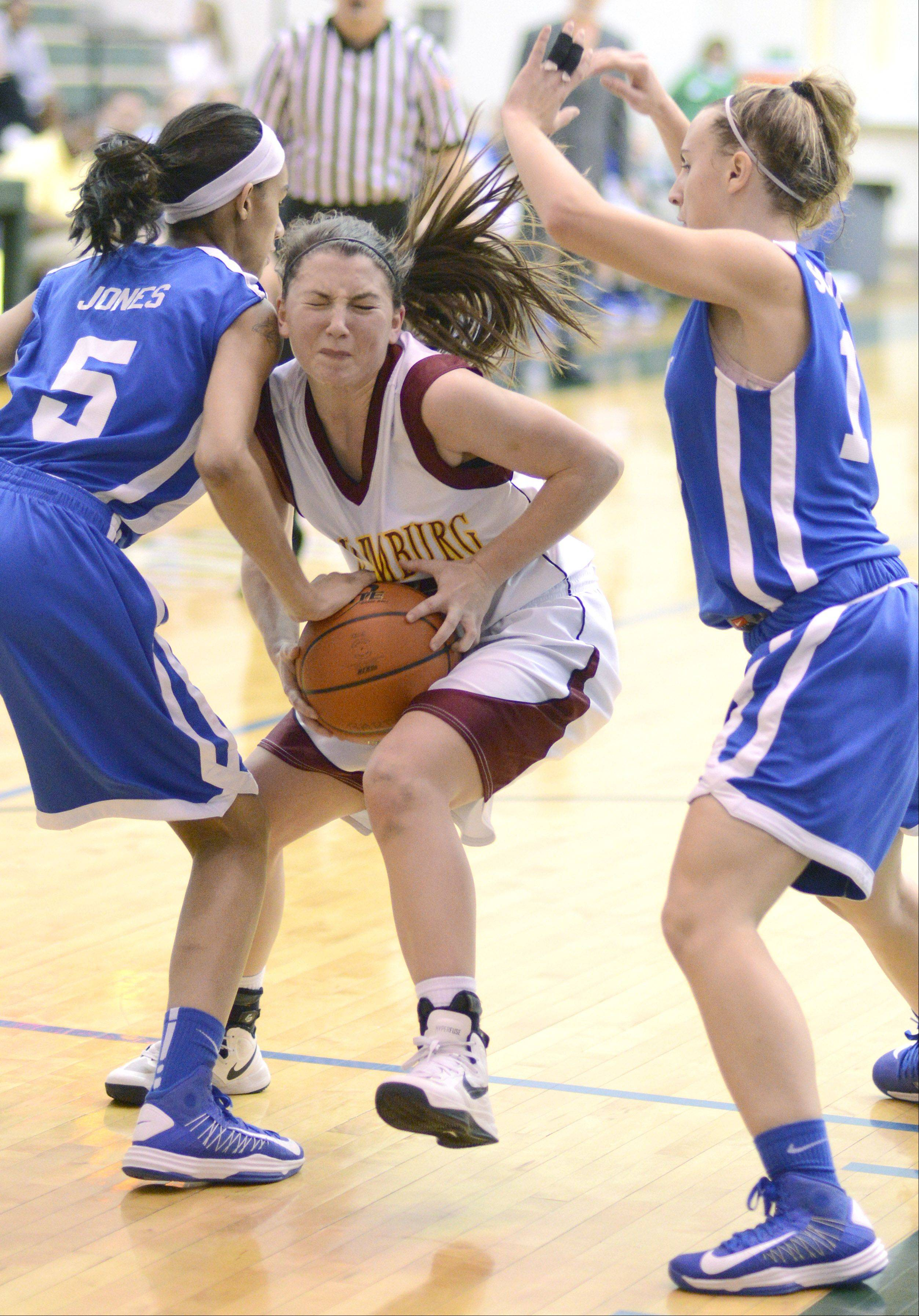 Schaumburg�s Amanda Kelly fights through a block by Wheaton North in the second quarter of the Class 4A regional game on Tuesday, February 19.