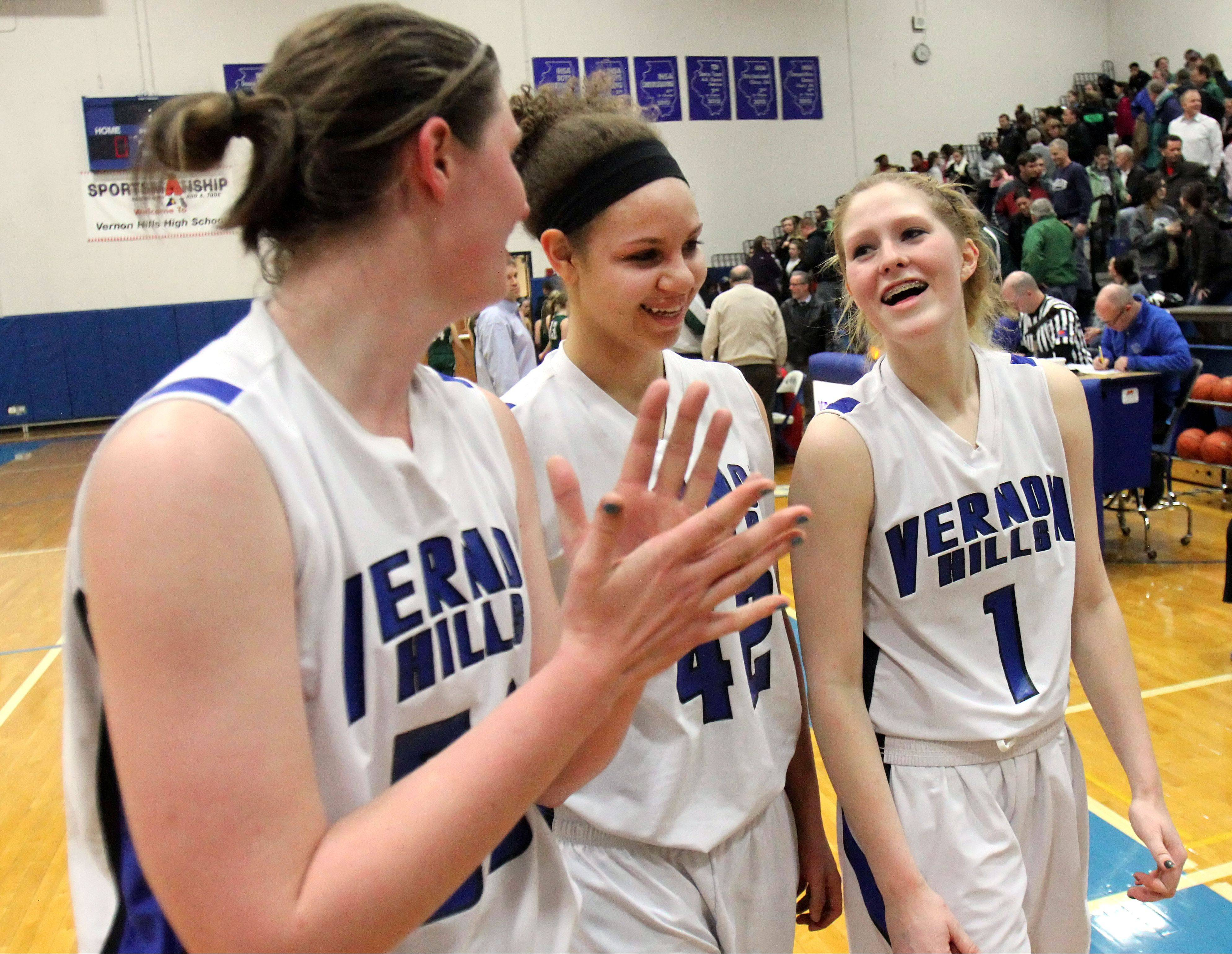 From left, Vernon Hills' Meri Bennett-Swanson, Lauren Webb and Sydney Smith are all smiles after beating Grayslake Central in Class 3A sectional semifinal play at Vernon Hills on Tuesday.