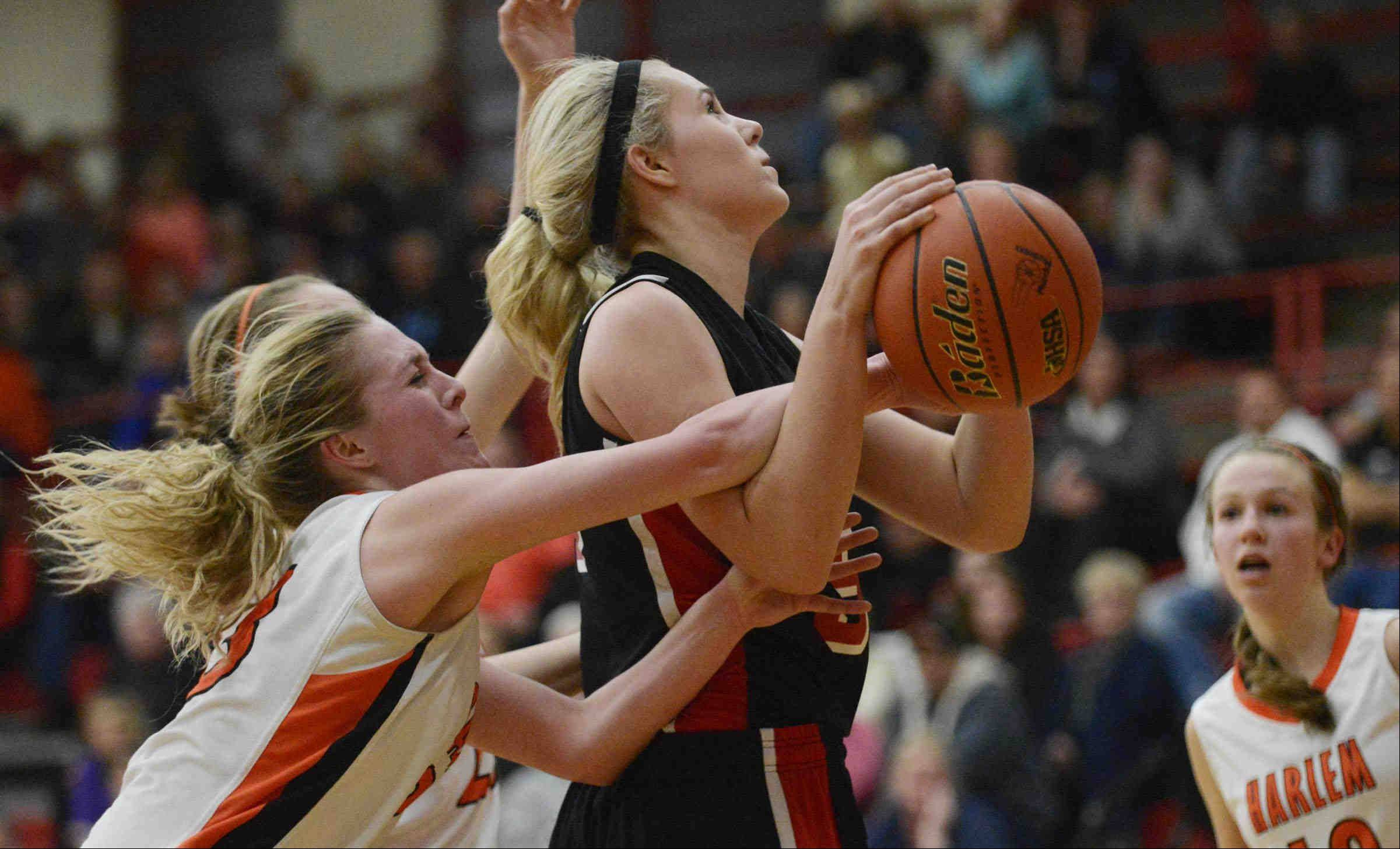 Huntley�s Ali Andrews is fouled by Harlem�s Serina Cortinez.