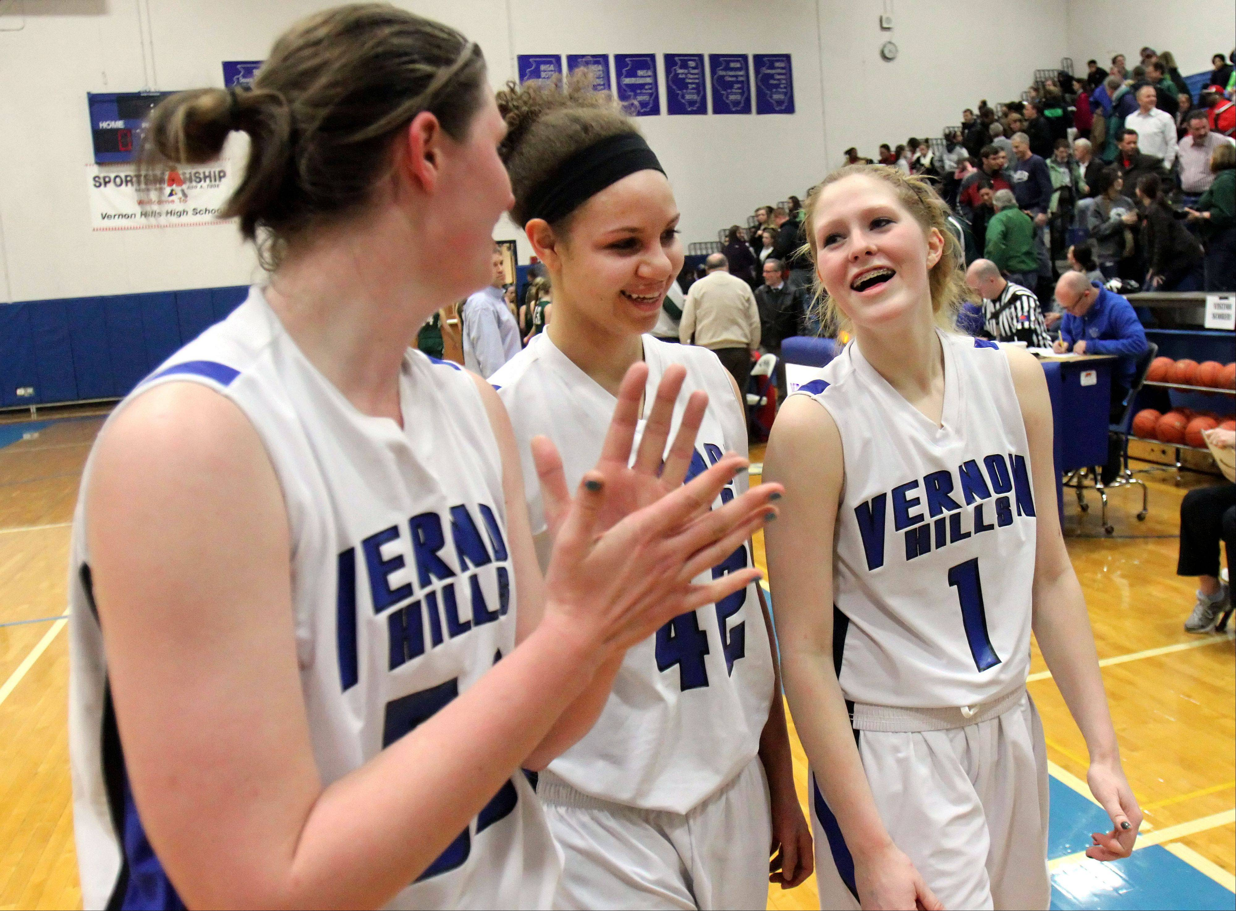 Vernon Hills players from left, Meri Bennett-Swanson, Lauren Webb and Sydney Smith are all smiles after beating Grayslake Central.