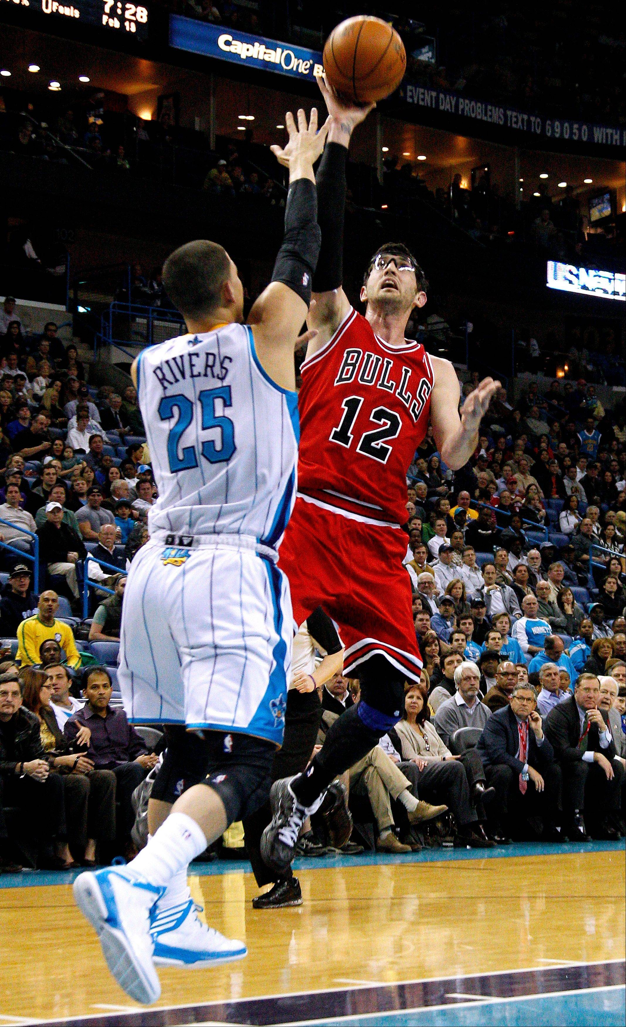 Chicago Bulls guard Kirk Hinrich (12) shoots over New Orleans Hornets guard Austin Rivers (25) during the first half of an NBA basketball game in New Orleans, Tuesday, Feb. 19, 2013. (AP Photo/Jonathan Bachman)