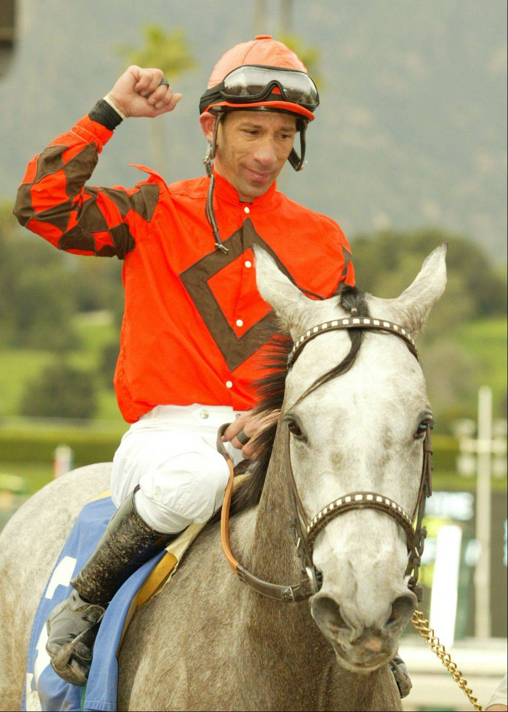 In this photo provided by Benoit Photo, jockey Rene Douglas gestures after riding Grey Misty to victory in the fifth race Thursday, Jan. 13, 2005, at Santa Anita Park in Arcadia, Calif. With the win, Douglas becomes the 122nd rider in North America to win 3,000 races.(AP Photo/Benoit Photo)