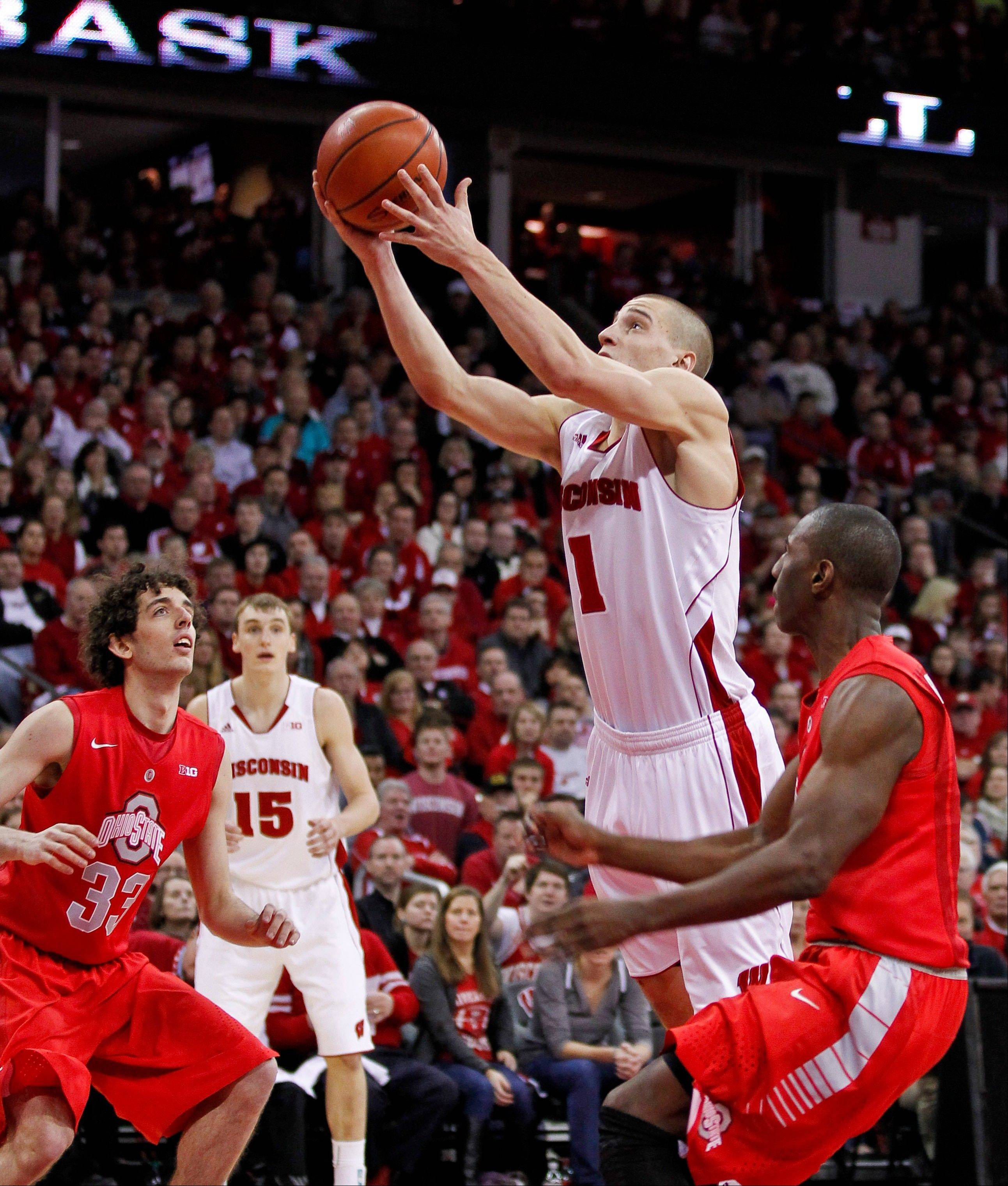 Wisconsin guard Ben Brust (1), a Mundelein grad, helped to lead Wisconsin in its upset over Ohio State Sunday. Now the Badgers take on Northwestern on Wednesday.