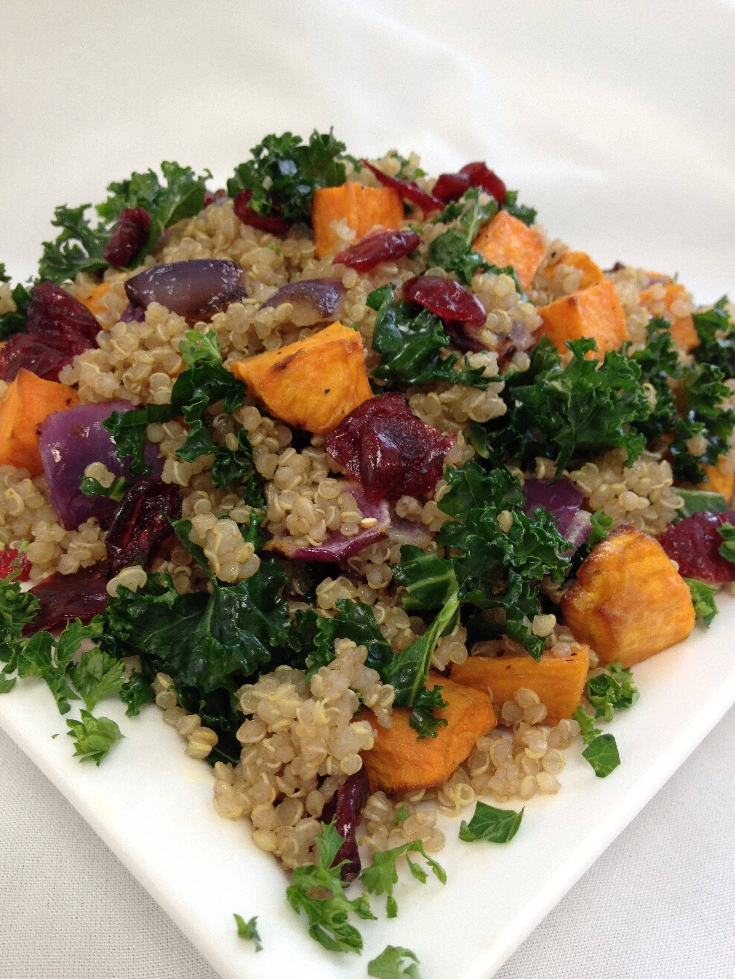 Whole grain quinoa combined with potatoes and vegetables comes to the table as a hearty side salad or a meatless entree.