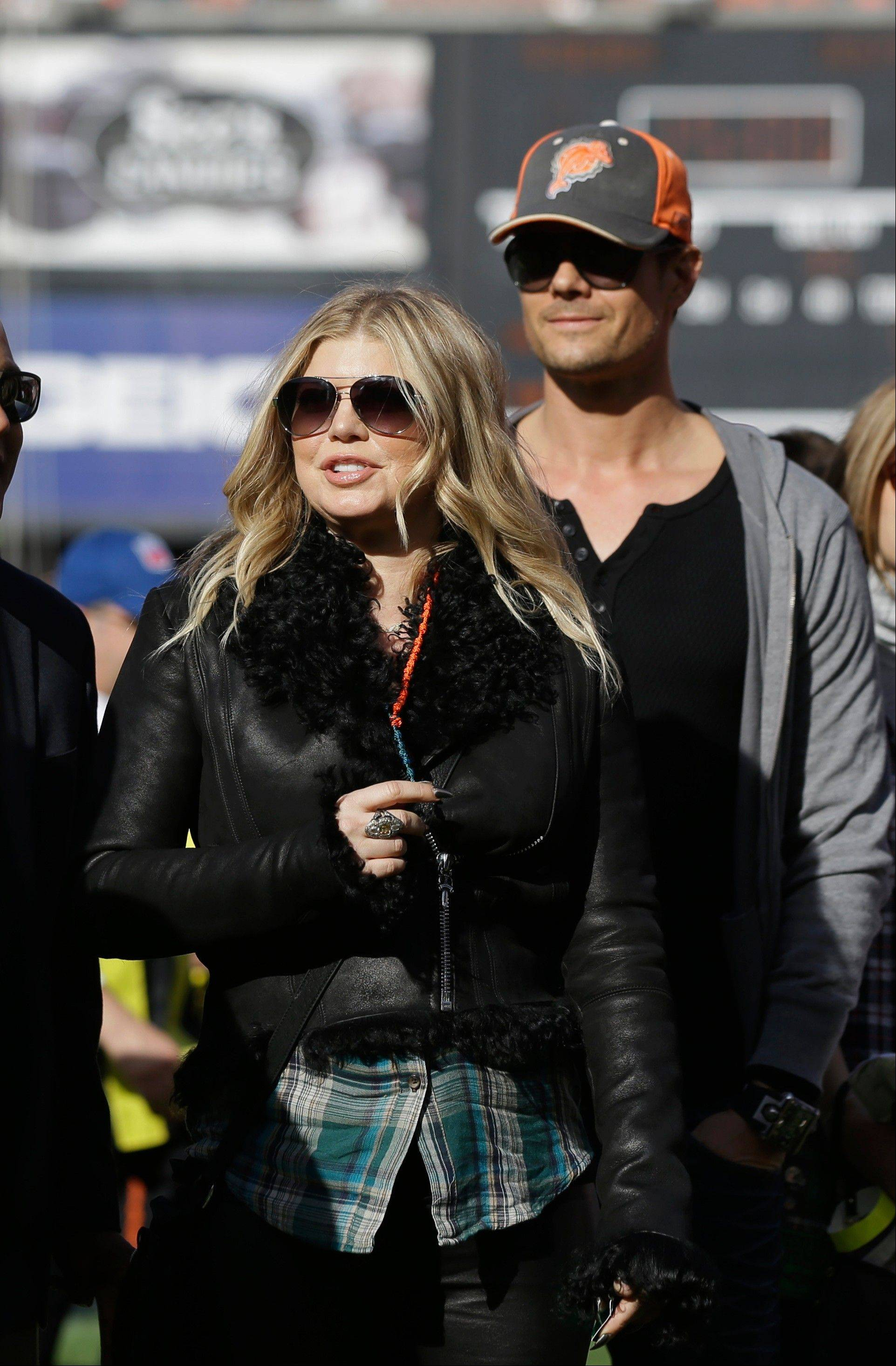 Singer Fergie of the Black Eyed Peas and her husband Josh Duhamel, right, are expecting their first child.