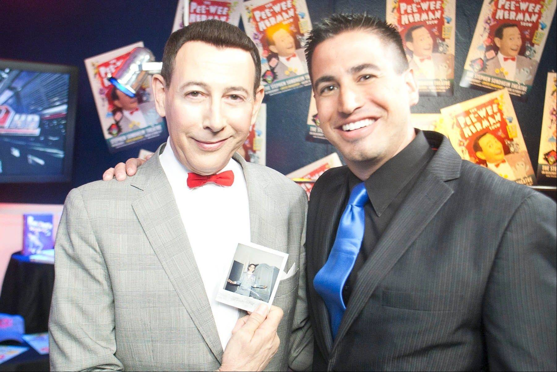 WWE announcer Justin Roberts, who grew up in Buffalo Grove, poses with Pee-wee Herman and a childhood photo of Roberts in his Pee-wee pajamas.