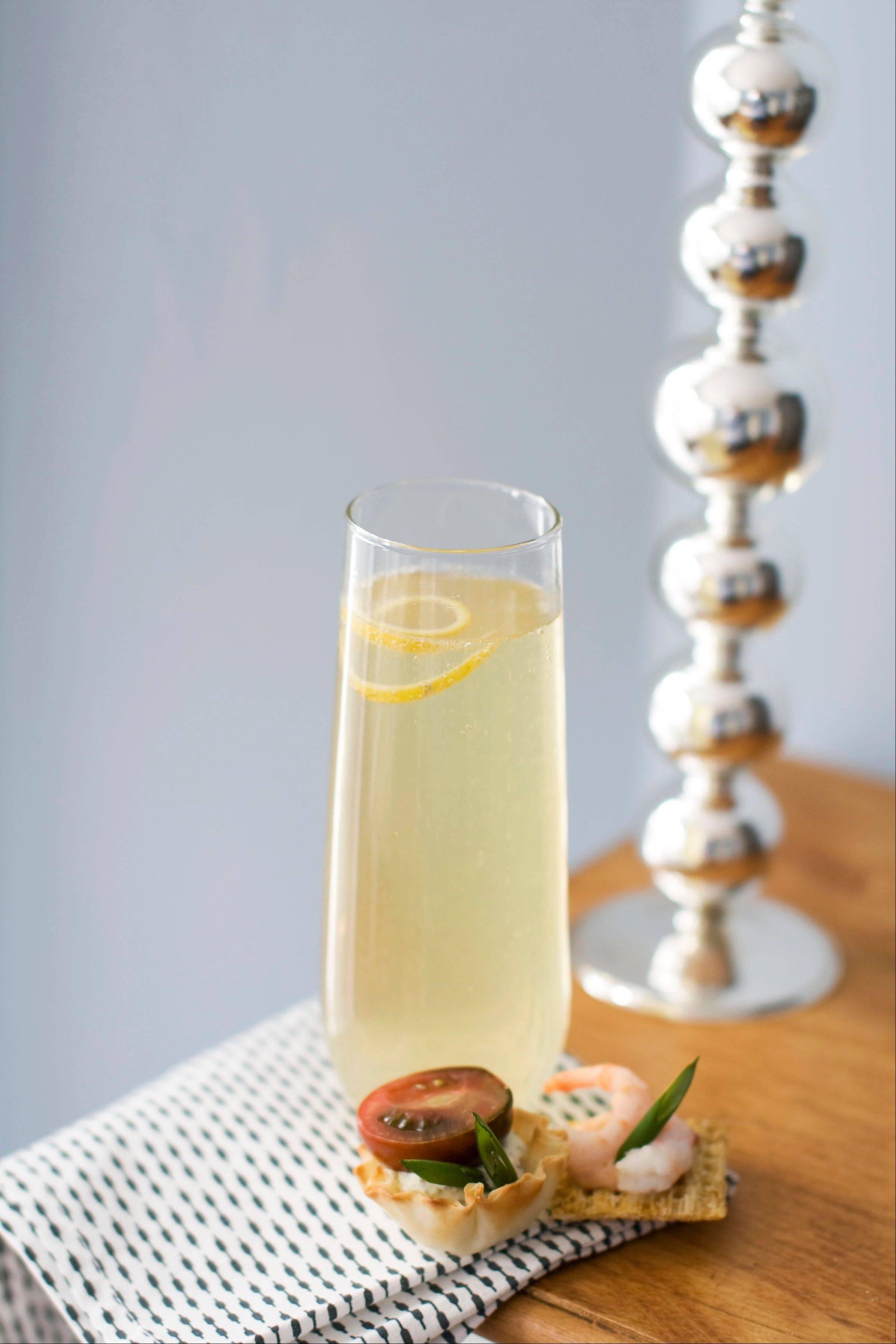 Citrus bubbly, served with a curl of lemon, is the perfect sipper for Oscar night festivities.