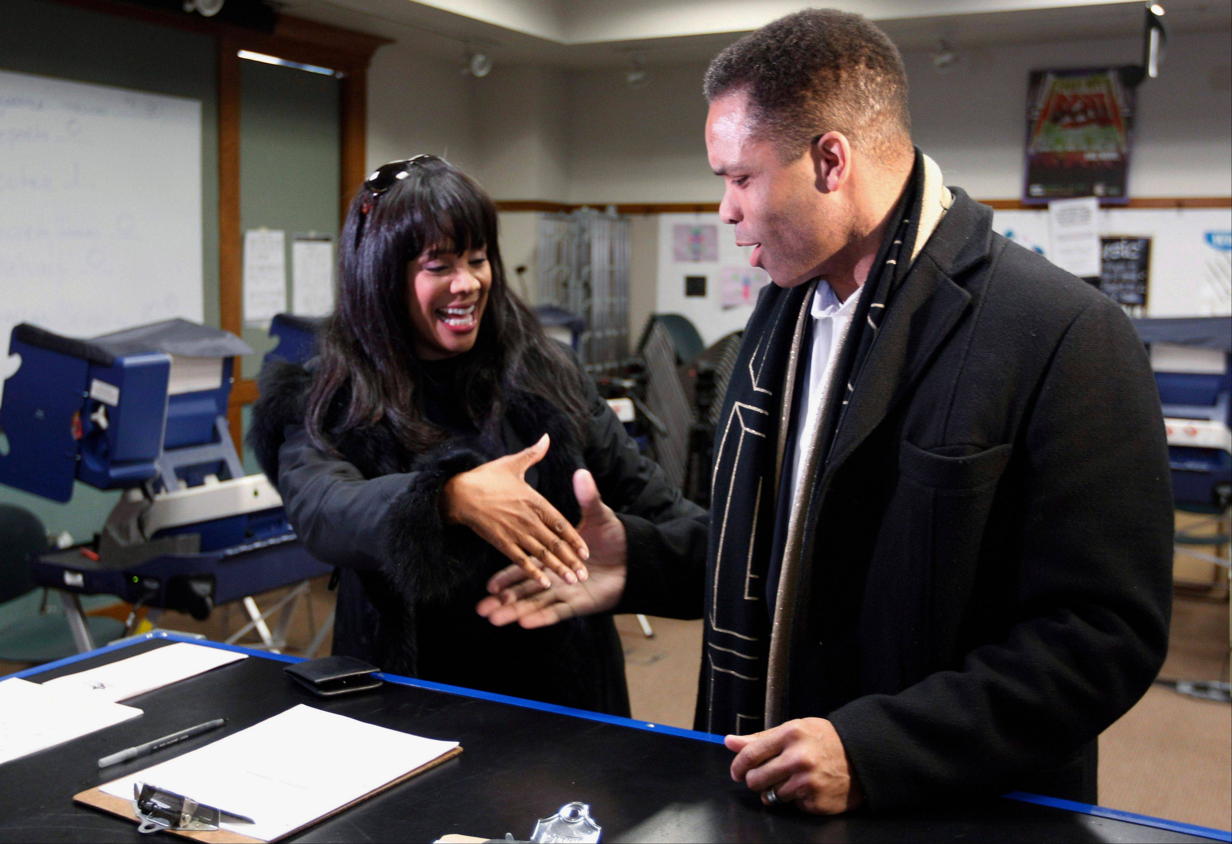 Then-Rep. Jesse Jackson Jr. and his wife, then-Alderman Sandra Jackson, ask for each other's support as they arrive at a polling station for early voting last March in Chicago.