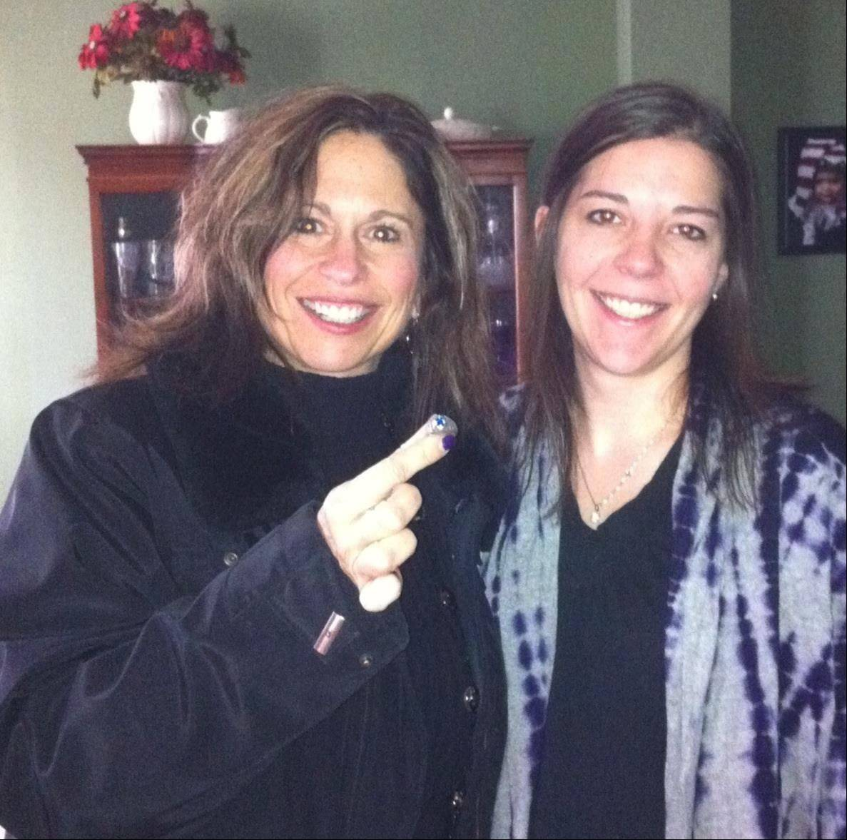 After 30 years, Beth Orticelli, left, was returned her Schaumburg High School class ring on Saturday. She had traded it with a friend who lived in Melissa Patterson's house after graduating from high school. Patterson, right, found the ring in her yard in October and tracked down Orticelli.