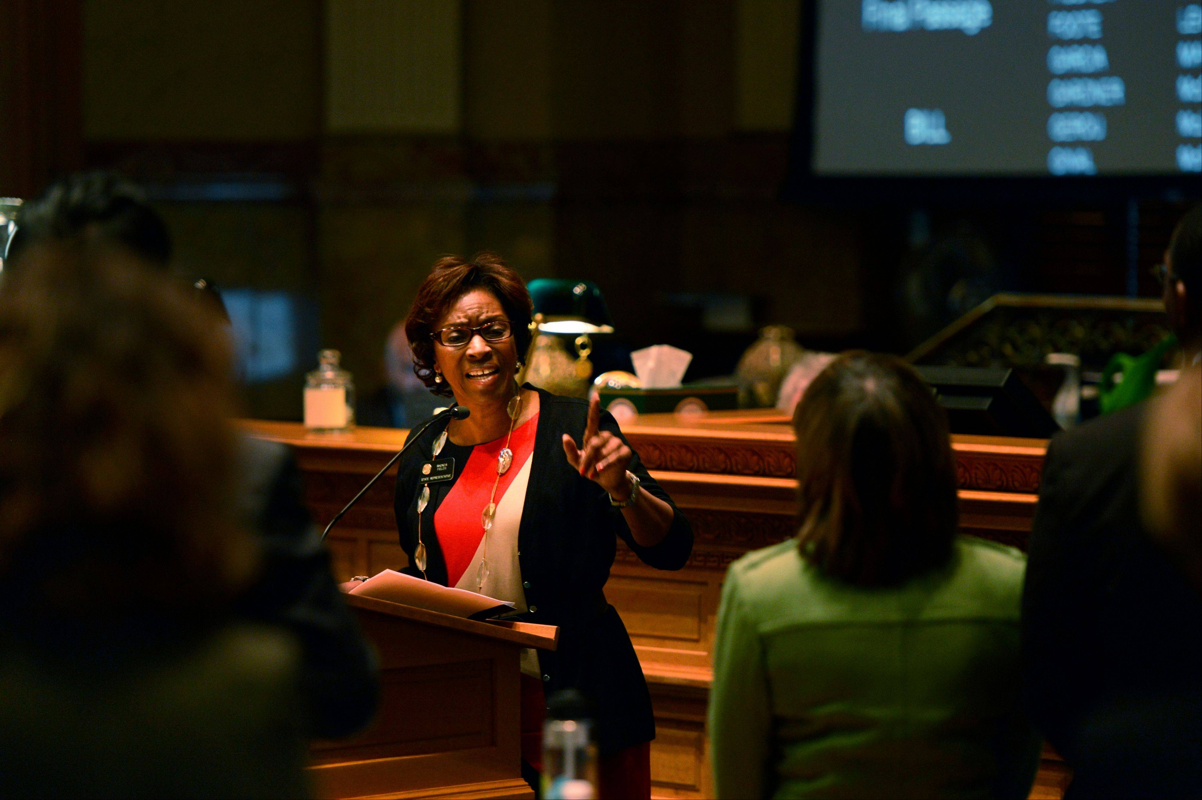Rep. Rhonda Fields, D-Aurora, speaks before the Colorado House as they consider her bill, HB13-1224, that prohibits large capacity ammunition magazines at the State Capitol in Denver, Monday, Feb. 18, 2013. Colorado House Democrats passed new ammunition limits and expanded background checks as part of a package of bills responding to recent mass shootings.