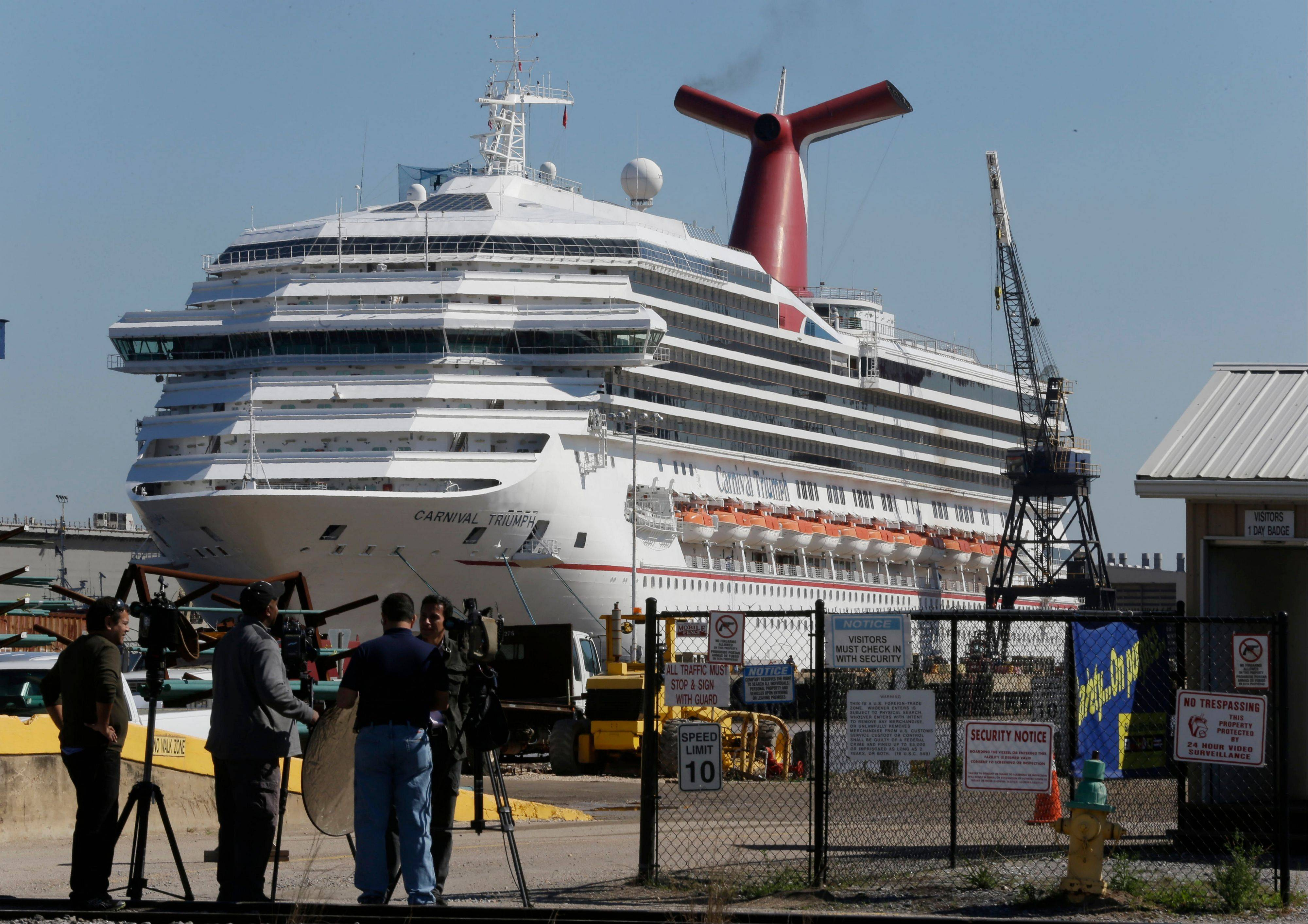 The cruise ship Carnival Triumph is moored at a dock in Mobile, Ala., Friday, Feb. 15, 2013.