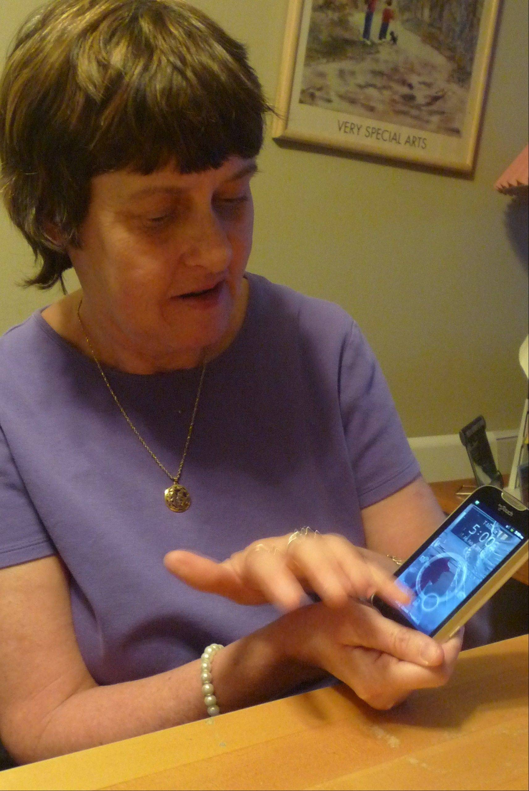 Having received help throughout her life, Cindy Moore has a good job and her own apartment in spite of a developmental disability. But she says buying this smartphone got her into trouble.