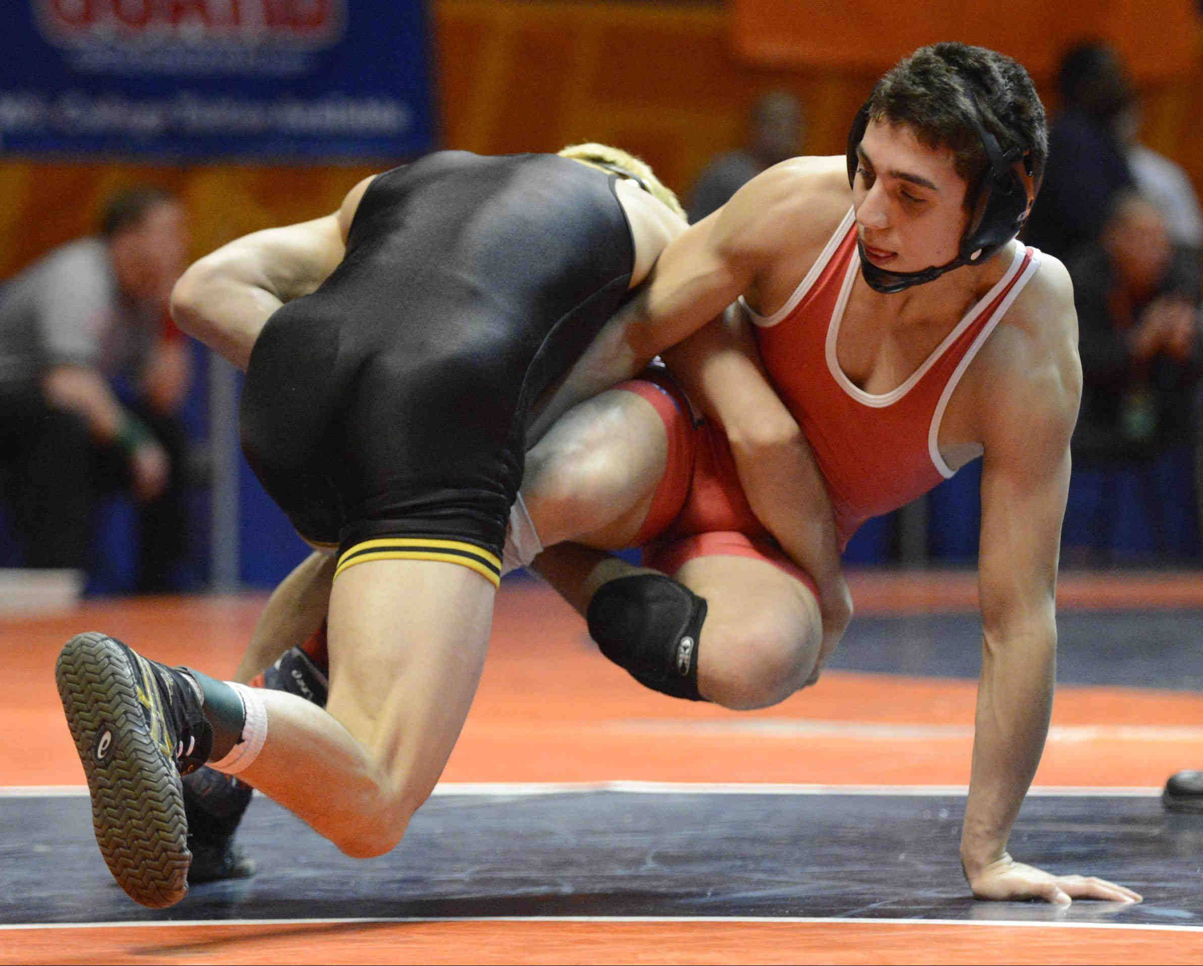 Marmion's Johnny Jimenez, pictured during a win Friday at the state individual tournament in Champaign, and the Cadets continued their season Tuesday by winning the Class 3A Hinsdale South team sectional.