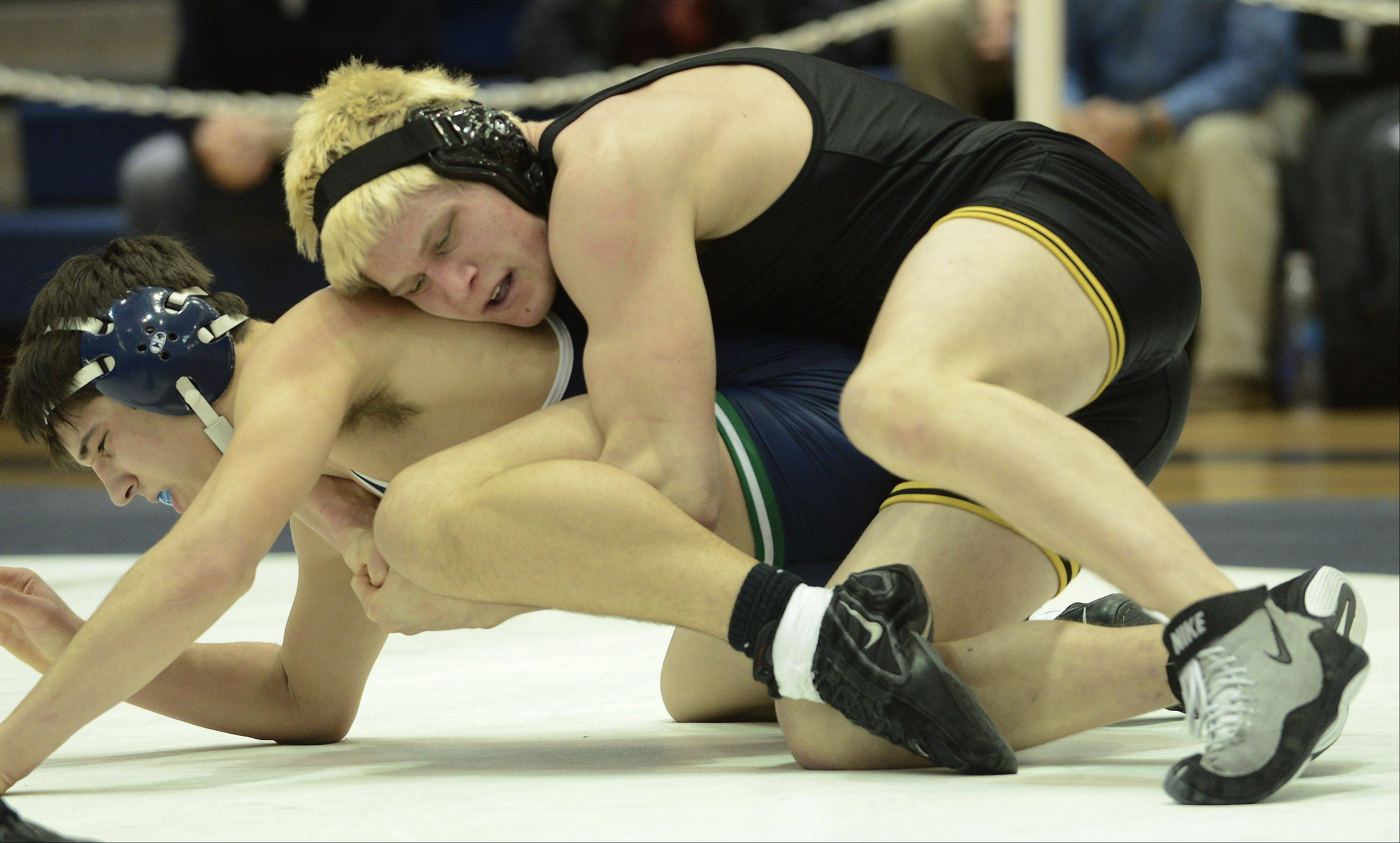Glenbard North's Evan Finger, top, wrestles Notre Dame's Marco Orlandi in the 182-pound match during the Class 3A wrestling sectional at Lake Park Tuesday.