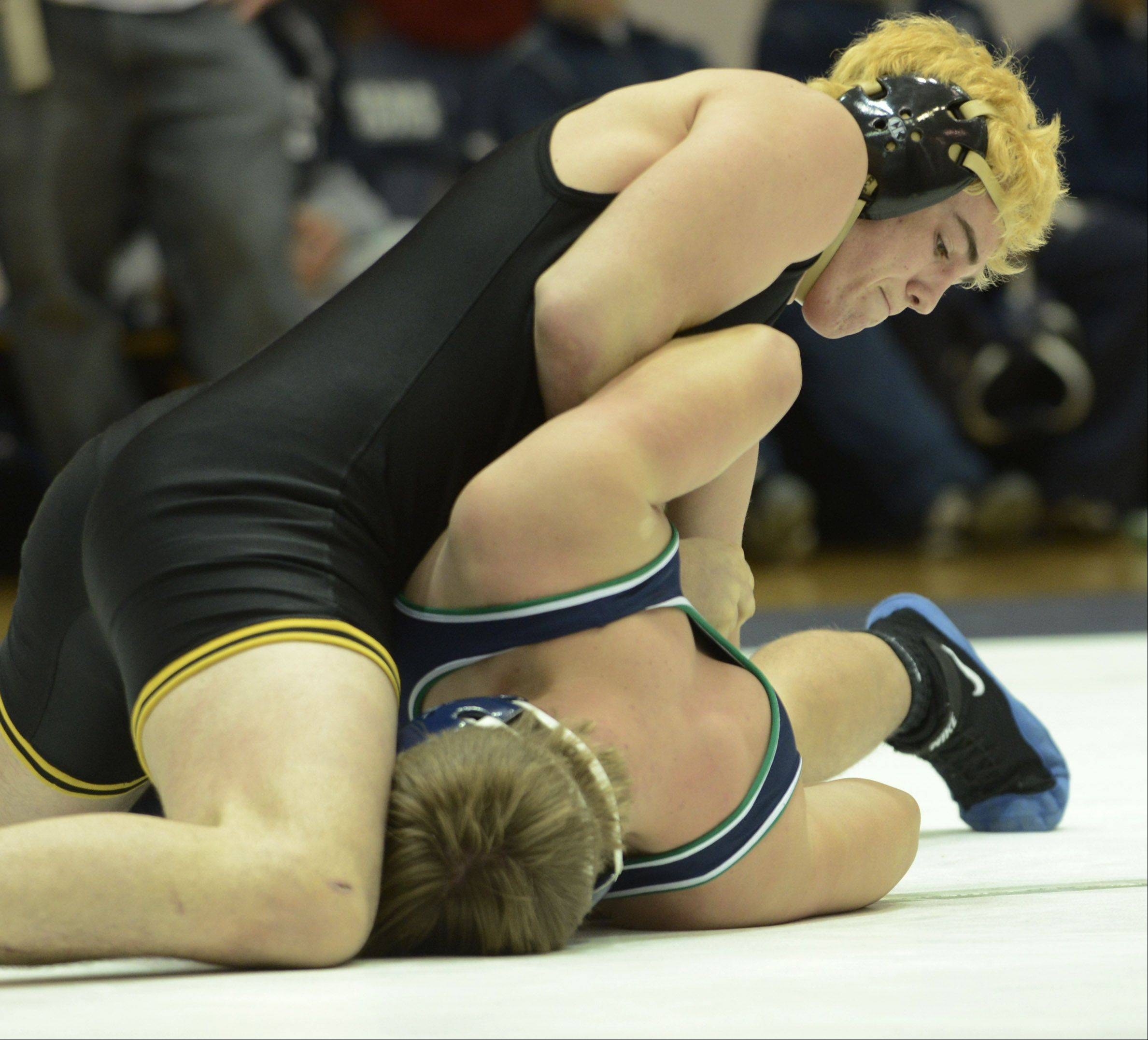 Glenbard North's Luke Greenberg, top, defeats Notre Dame's Brian Brand in the 195-pound match during the Class 3A wrestling sectional at Lake Park Tuesday.