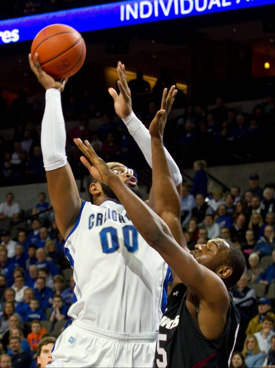 Creighton's Gregory Echenique (00) shoots over Southern Illinois' Dantiel Daniels (15) during the first half of their NCAA college basketball game, Tuesday, Feb. 19, 2013, in Omaha, Neb. Creighton won 59-45. (AP Photo/The World-Herald, Mark Davis) MAGS OUT; ALL NEBRASKA LOCAL BROADCAST TV OUT