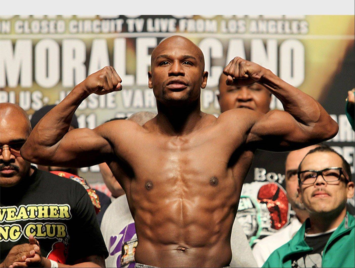 "Undefeated eight-time Boxing World Champion Floyd ""Money"" Mayweather Inks Record-Breaking Deal With Showtime/CBS. (PRNewsFoto/Mayweather Promotions)"