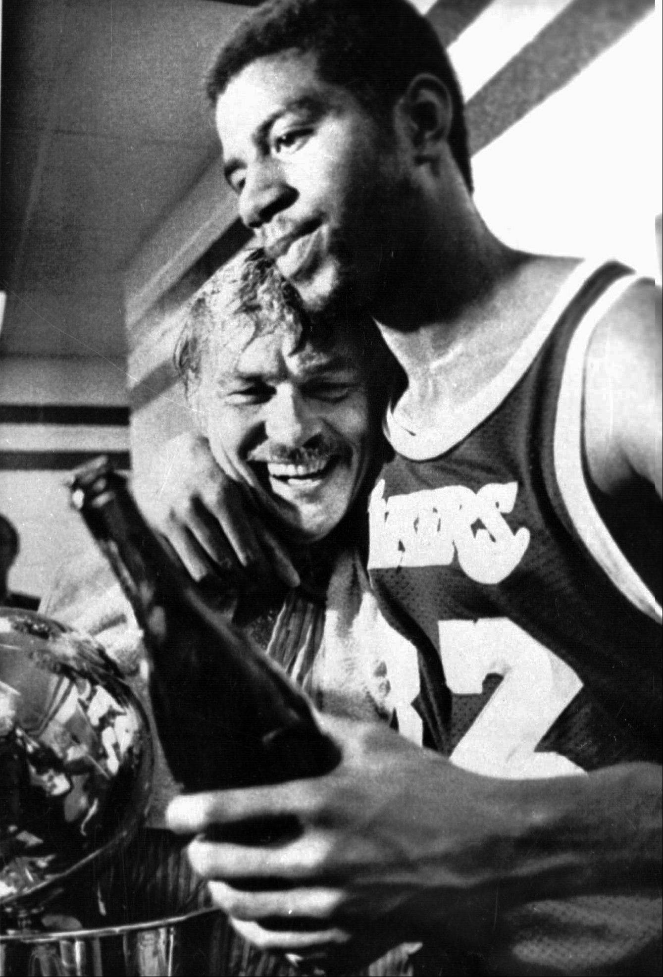 "In this May 17, 1980, file photo, Earvin ""Magic"" Johnson hugs team owner Jerry Buss in the locker room after the Los Angeles Lakers won the 1980 NBA championship against the Philadelphia 76ers in Philadelphia. Buss, the Lakers' owner who shepherded the NBA franchise to 10 championships, died Monday. He was 80."