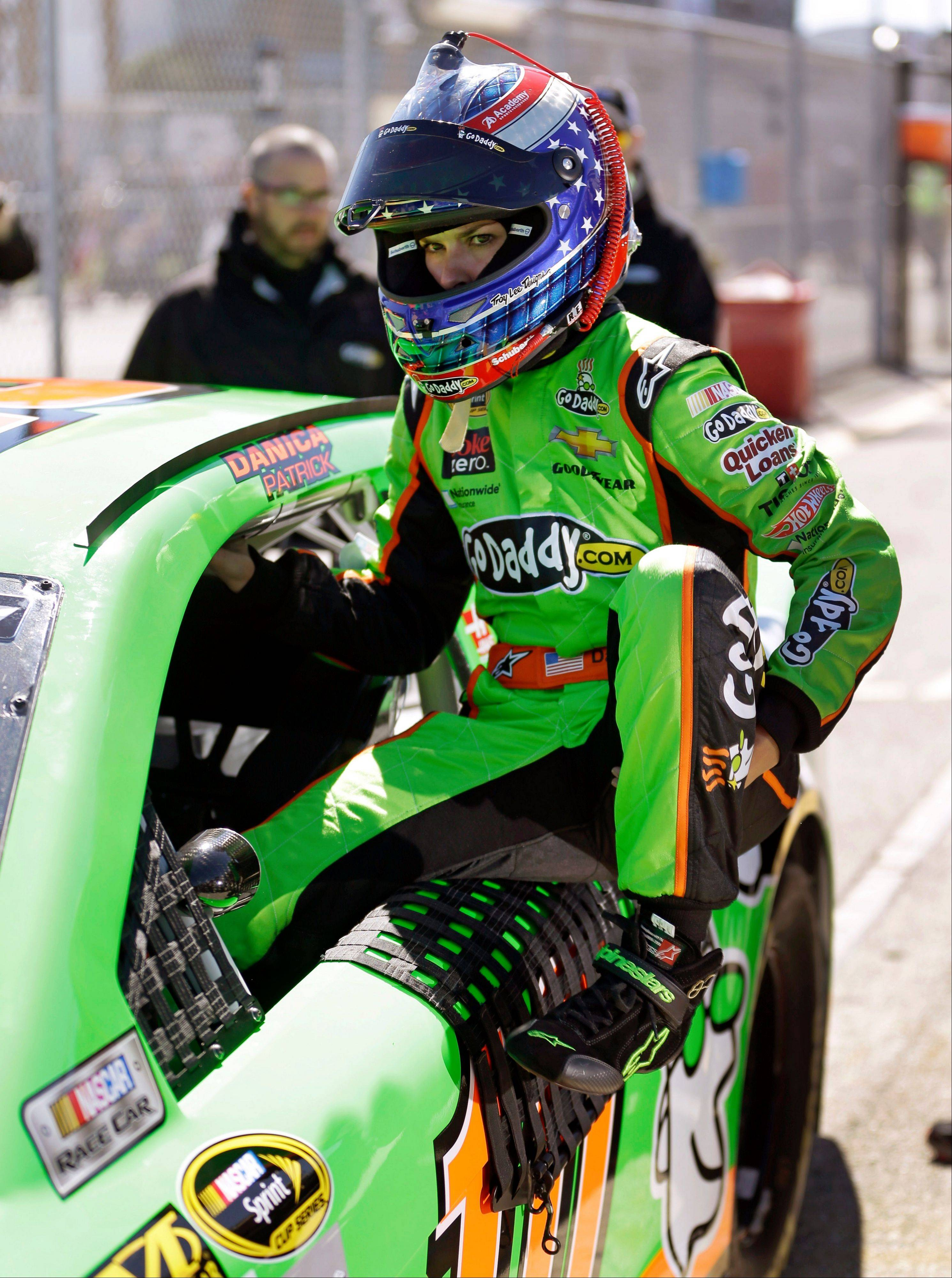Danica Patrick climbs out of her car after her qualifying run for the NASCAR Daytona 500 Sprint Cup Series auto race at Daytona International Speedway, Sunday, Feb. 17, 2013, in Daytona Beach, Fla. Patrick won the pole, becoming the first woman to secure the top spot for any Sprint Cup race.