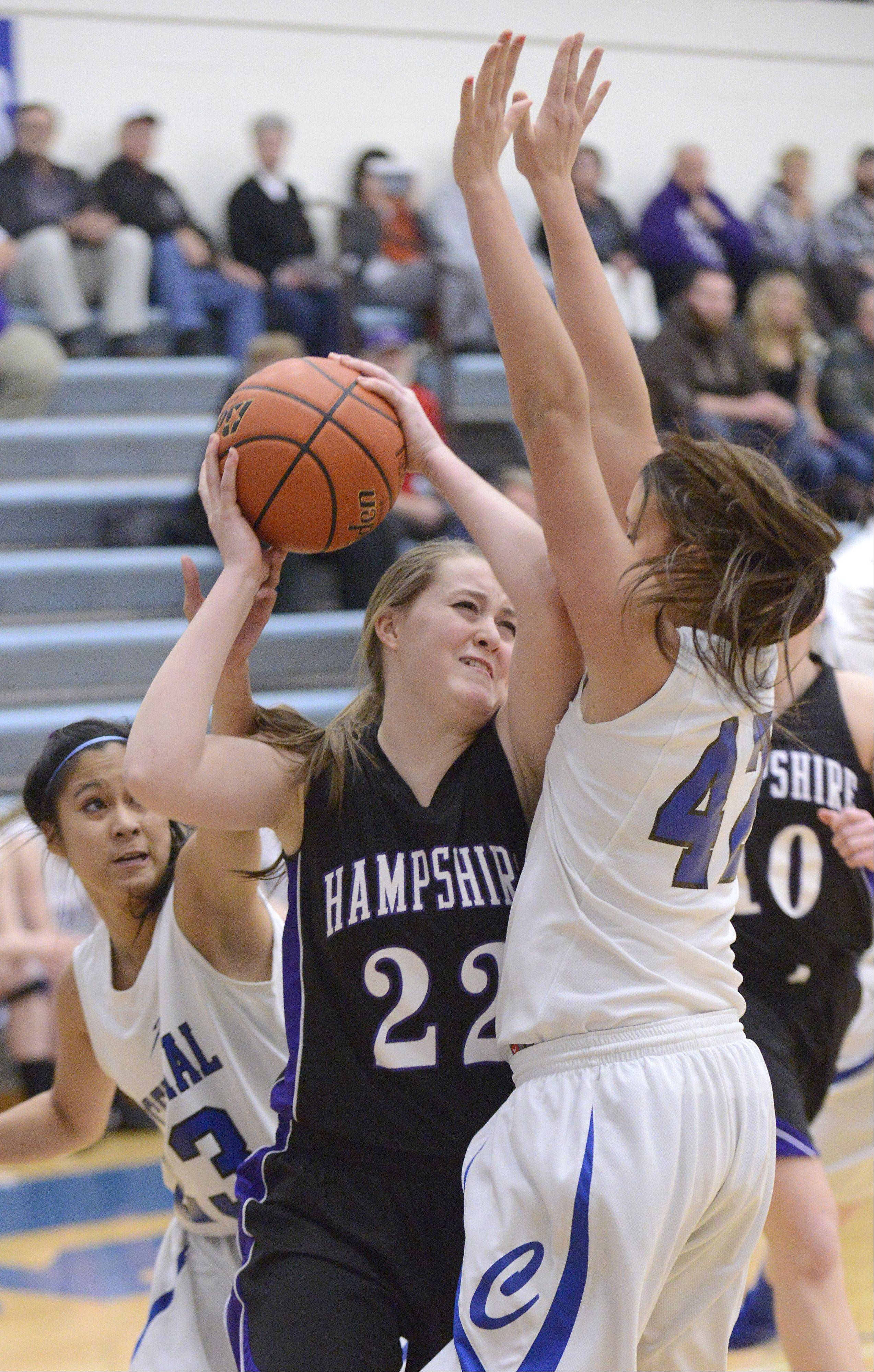 Hampshire's Emma Beniot is covered by Burlington Central's Camille Delacruz and Alison Colby during Wednesday's Class 3A regional basketball game.