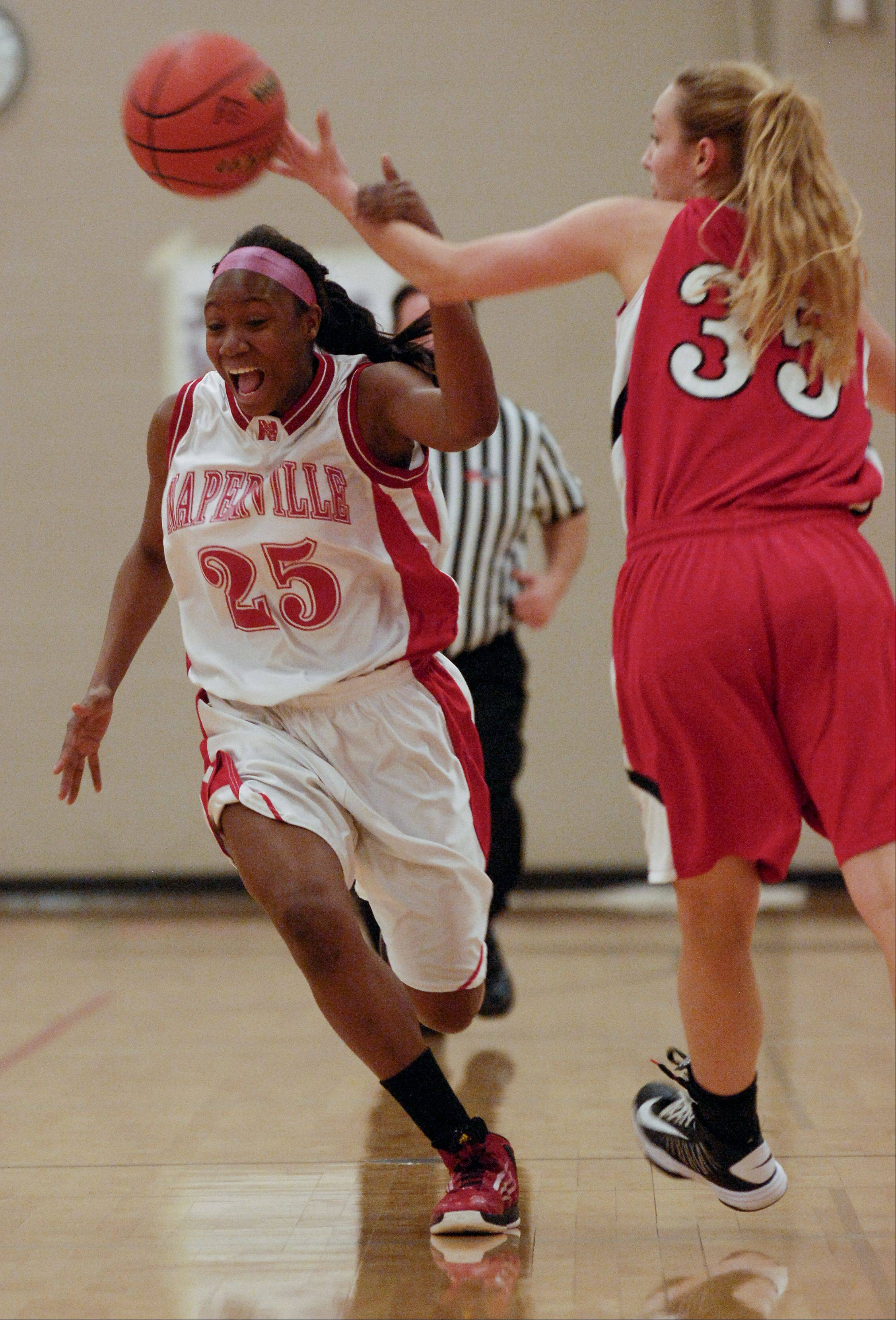 Naperville Central's Cierra Stanciel gives up control of the ball to Benet's Emily Eshoo during Thursday's Class 4A regional final basketball game in Lisle.