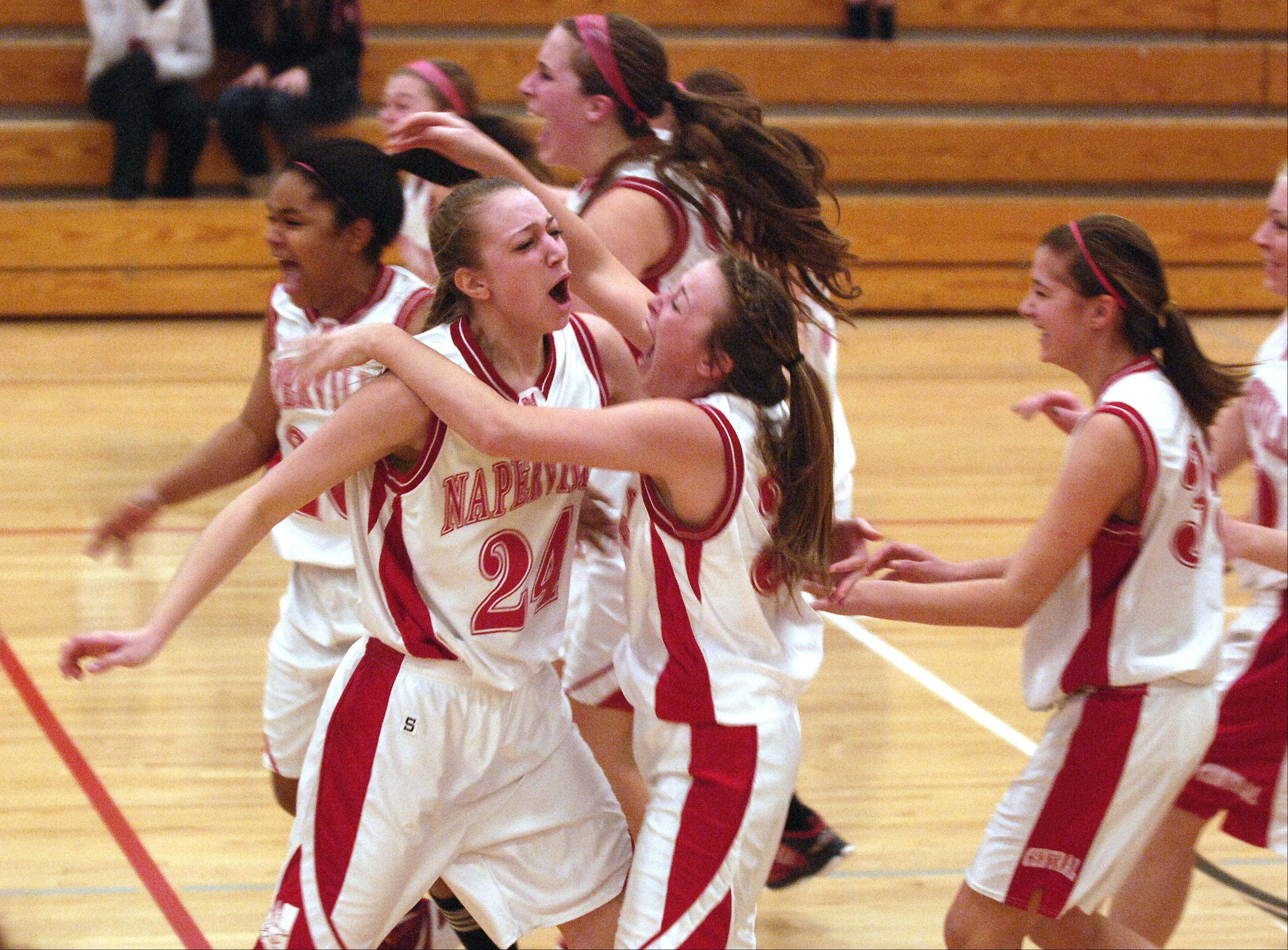Naperville Central celebrates their Class 4A regional final win over Benet Thursday in Lisle.