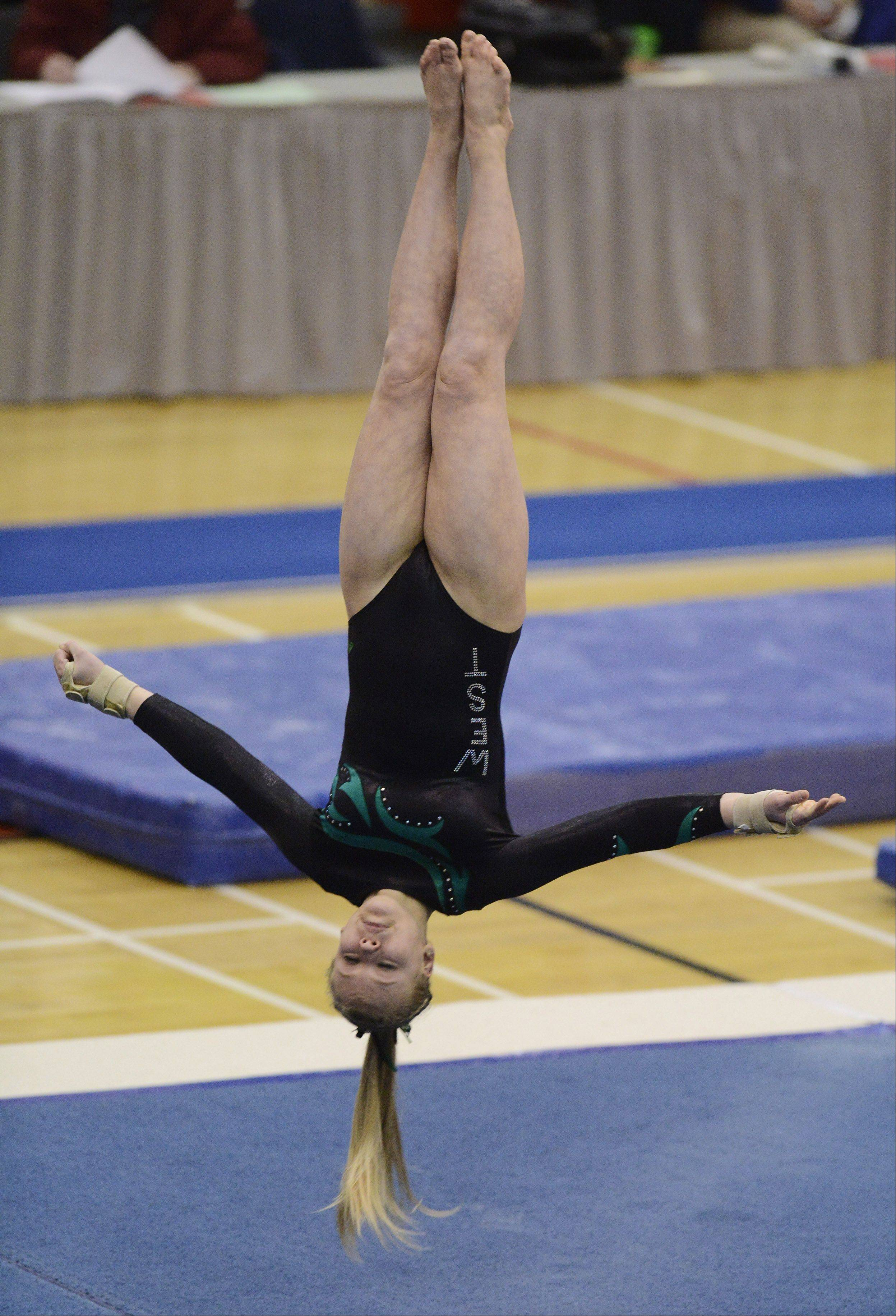 Glenbard West's Amber Broucek competes on the floor exercise during the girls state gymnastics preliminaries at Palatine High School Friday.