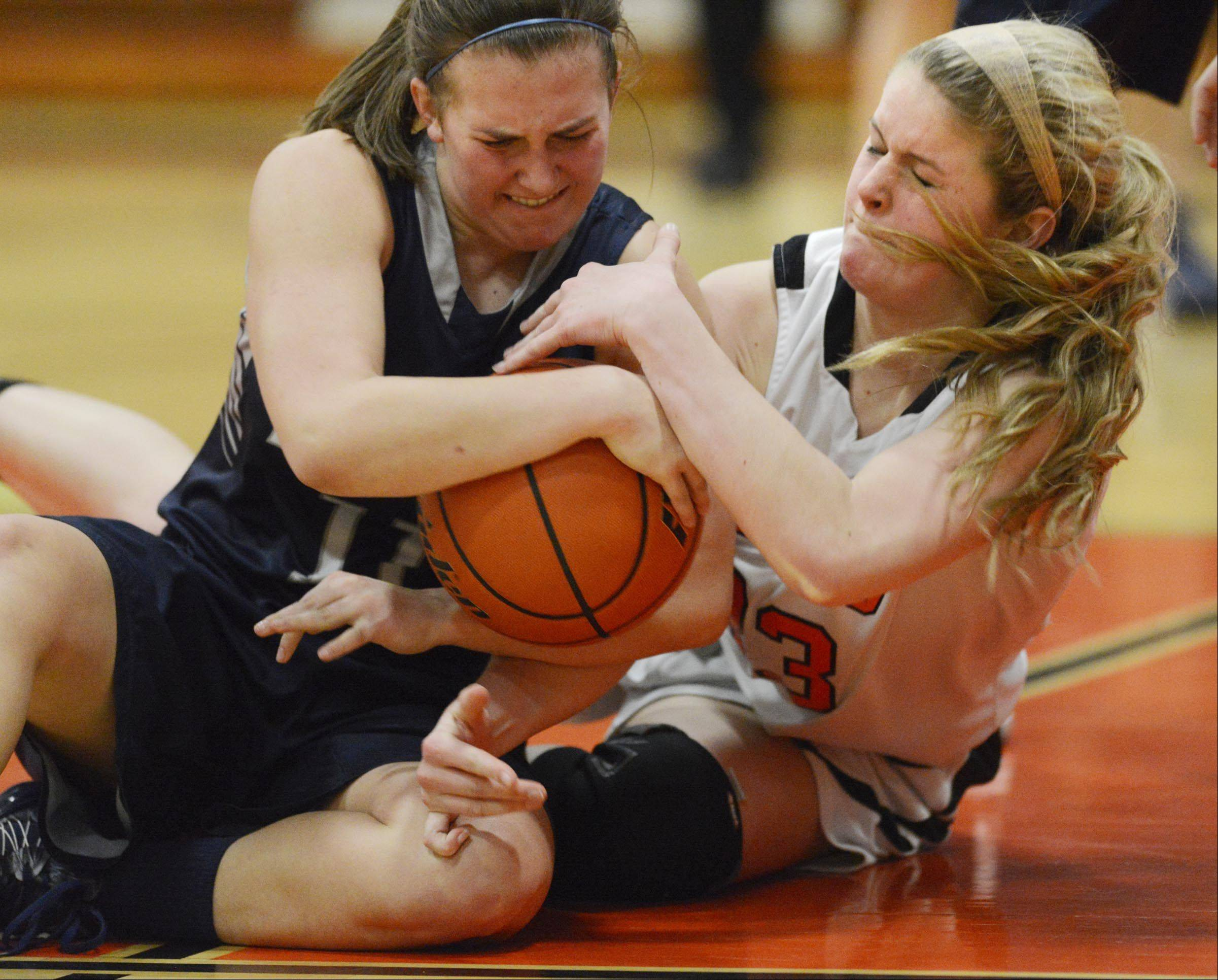 St. Charles East's Hannah Nowling and Lake Park's Emily Duckhorn struggle for the ball Monday in St. Charles.