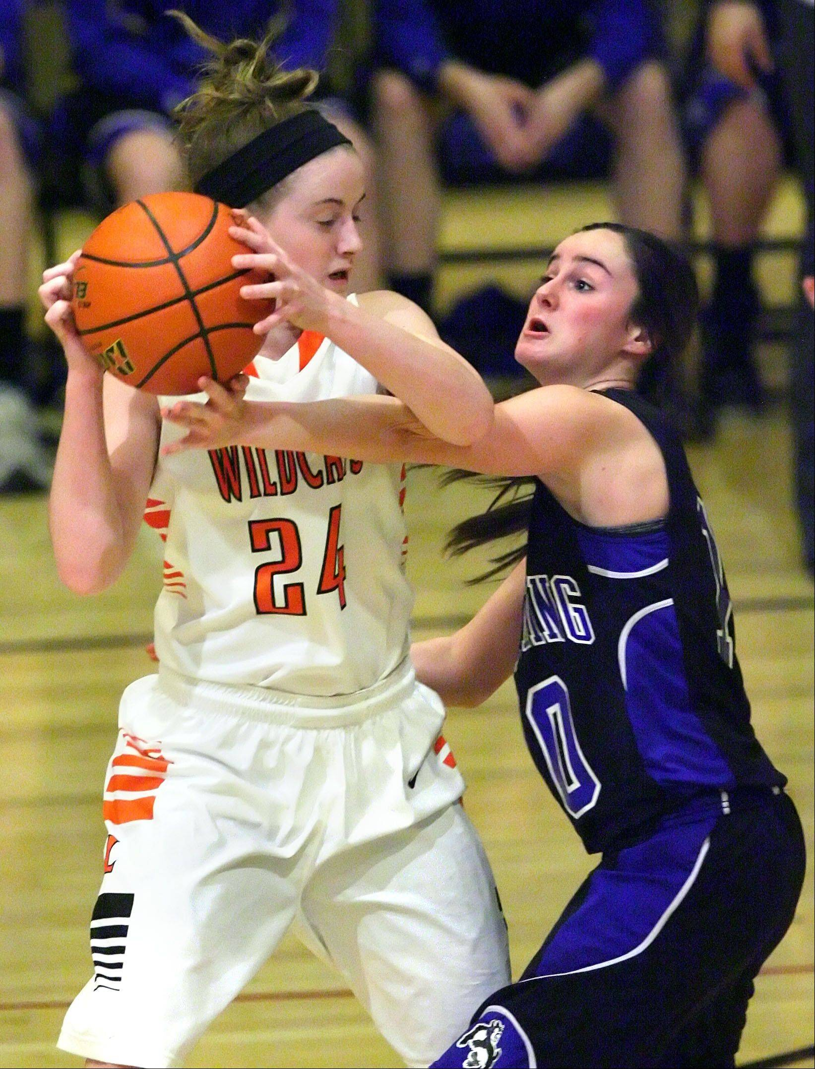 Libertyville's Rosie Lynch and Wheeling's Gianna Calistro battle for the ball during Monday's Class 4A regional game at Wheeling High School.