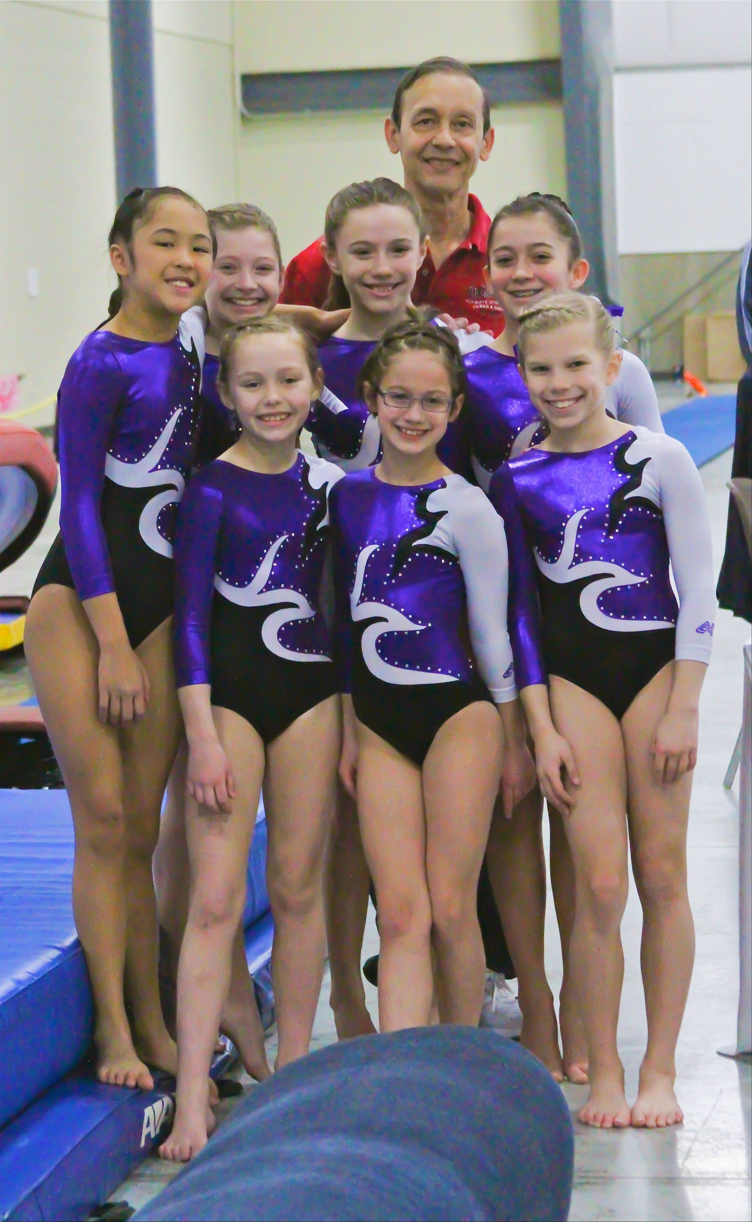 Members of the Level 6 girls team from Ultimate Gymnastics of Gurnee celebrate their first-place finish at the St. Valentine's Classic meet held recently at the Lake County Fairgrounds. Pictured with Coach Raul Rendon are, from left, back row: Sabrina Panlaqui, Jenna Ritzert, Hannah McCue and Delaney Jones; front row: Abbie Bosko, Emily Isabelli and Lyndsey Basara.