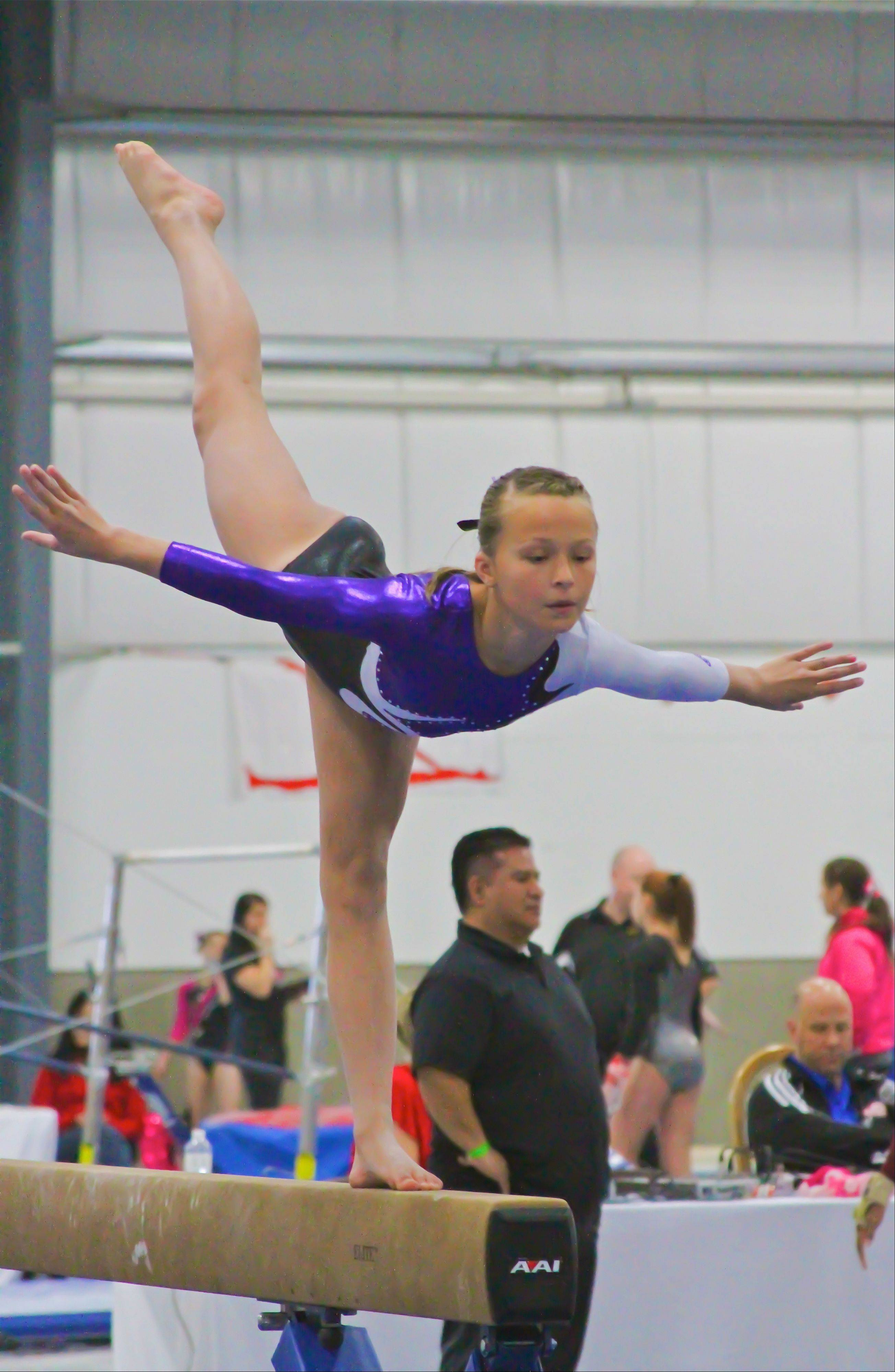 Lake Villa's Ally Weihs performs her beam routine at the recent St. Valentine's Classic meet. Ally, who competes as a Level 6 gymnast for Ultimate Gymnastics of Gurnee, took first place on beam in the 11-year-old age group, scoring 9.45.