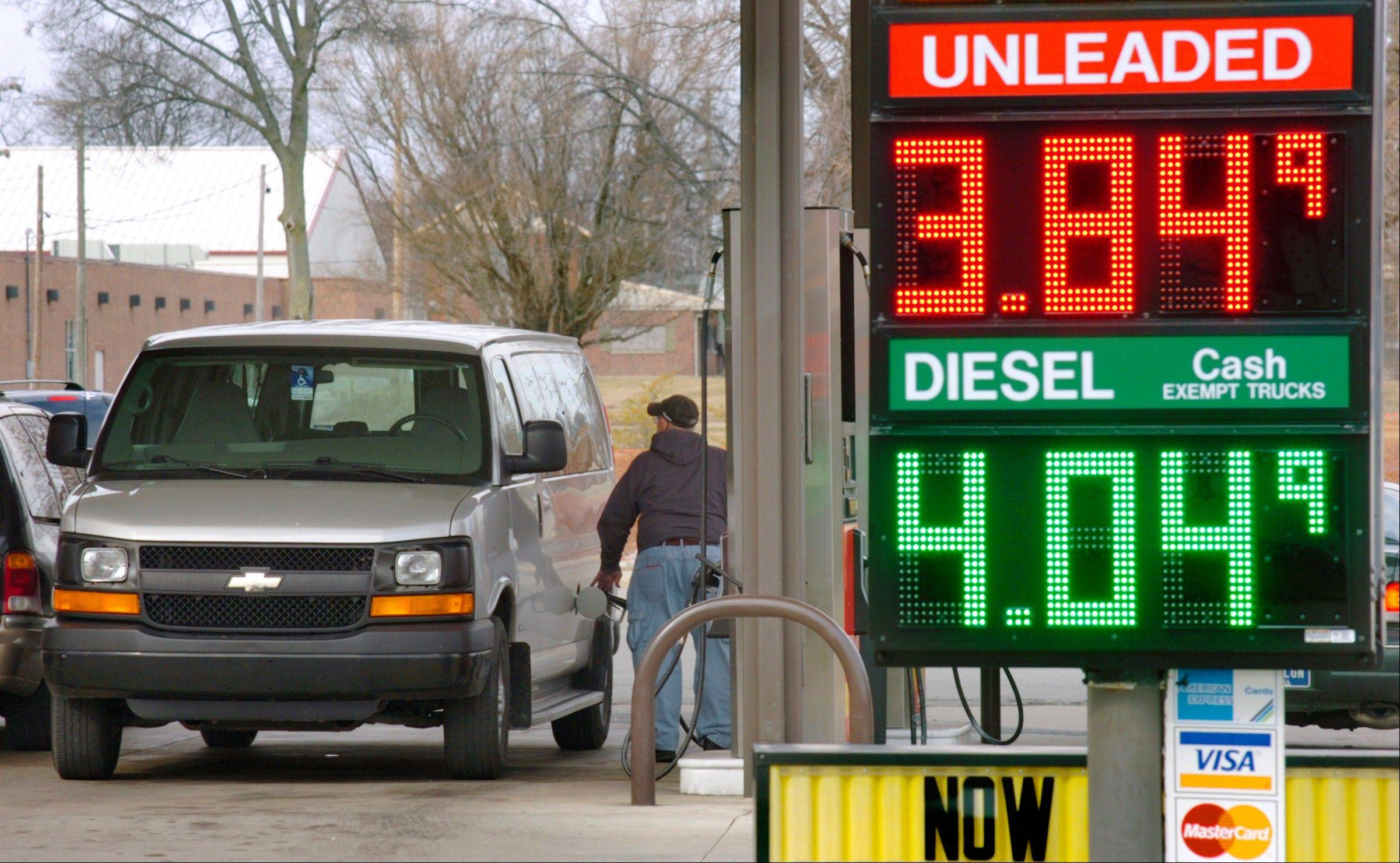 A customer buys gas at a McClure store in Marion, Ind., on Monday, Feb. 18, 2013. With gas prices at around $3.85 a gallon, and other costs rising, many Indiana families are struggling to pay bills.