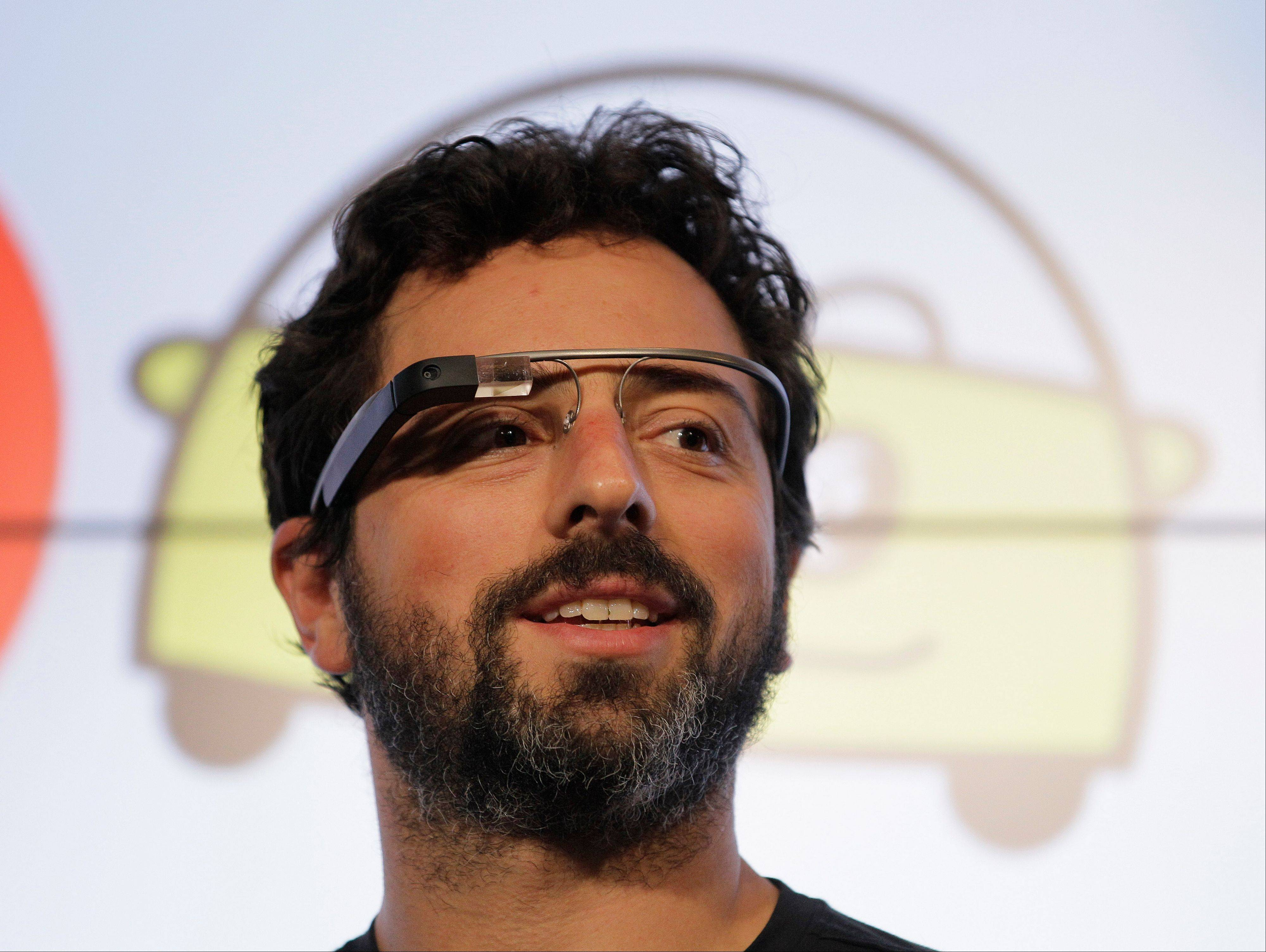 Google co-founder Sergey Brin is seen wearing a �Google Glass� last September. The company said Wednesday it is giving a few more people a chance to pay $1,500 for a pair of the Internet-connected glasses that the company is touting as the next breakthrough in mobile computing.