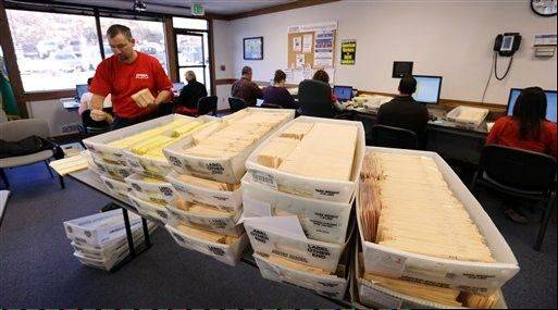 Workers begin to validate returned ballots at the headquarters of the union for Boeing Co.'s engineers and technical workers, Tuesday in Tukwila, Wash.