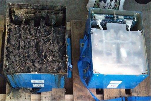 This Jan. 17, 2013 photo shows the distorted main lithium-ion battery, left, and an undamaged auxiliary battery of the All Nippon Airways' Boeing 787 ,