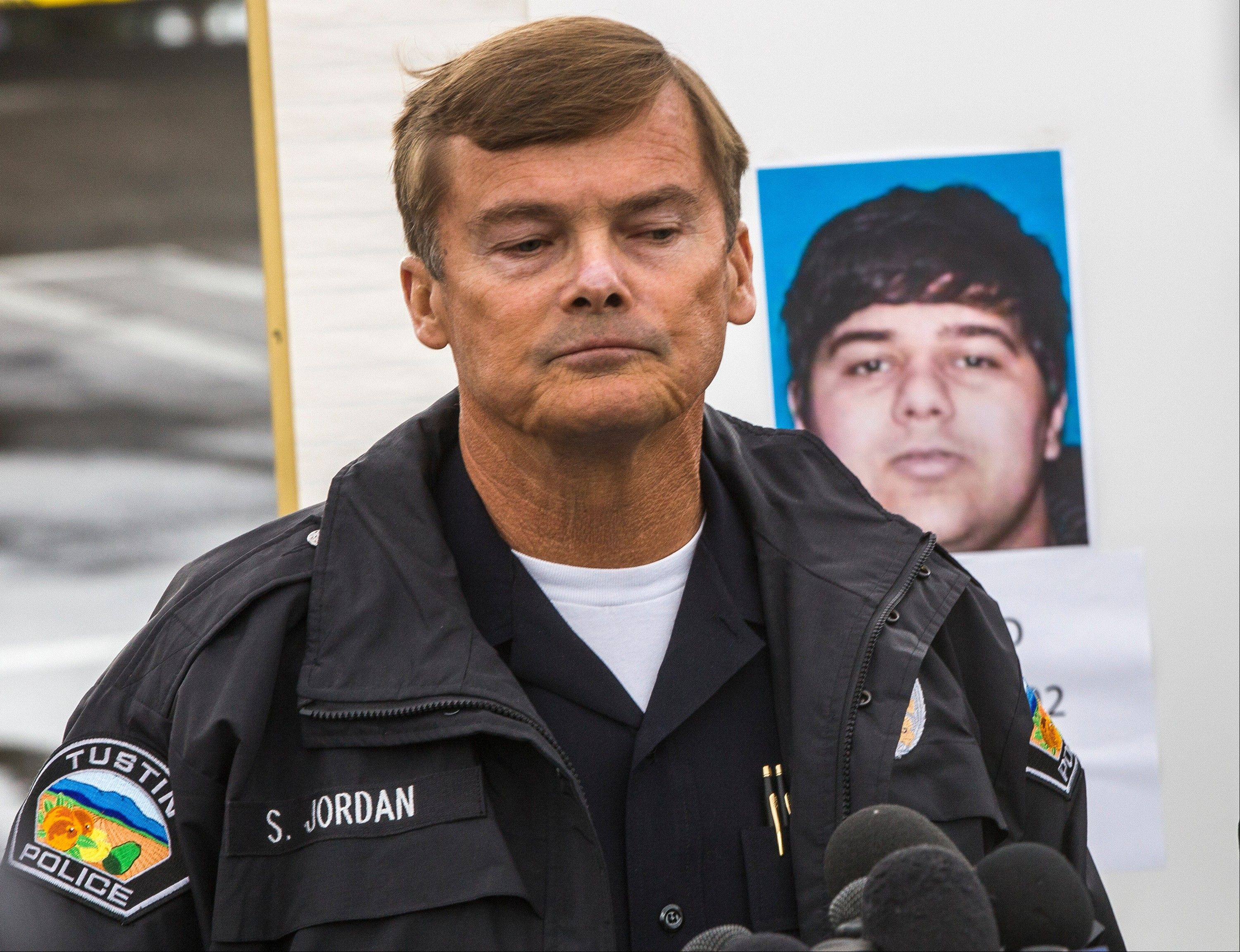 Tustin Police Chief Scott Jordan takes questions about the gunman, Ali Syed, a suspect in a series of shootings during a news conference in Tustin, Calif., Tuesday, Feb. 19, 2013. In less than an hour, Syed, an unemployed part-time student, shot and killed a woman in her home and two commuters during carjackings early Tuesday, shot up vehicles on a Southern California freeway and committed suicide as police closed in on him, authorities said.