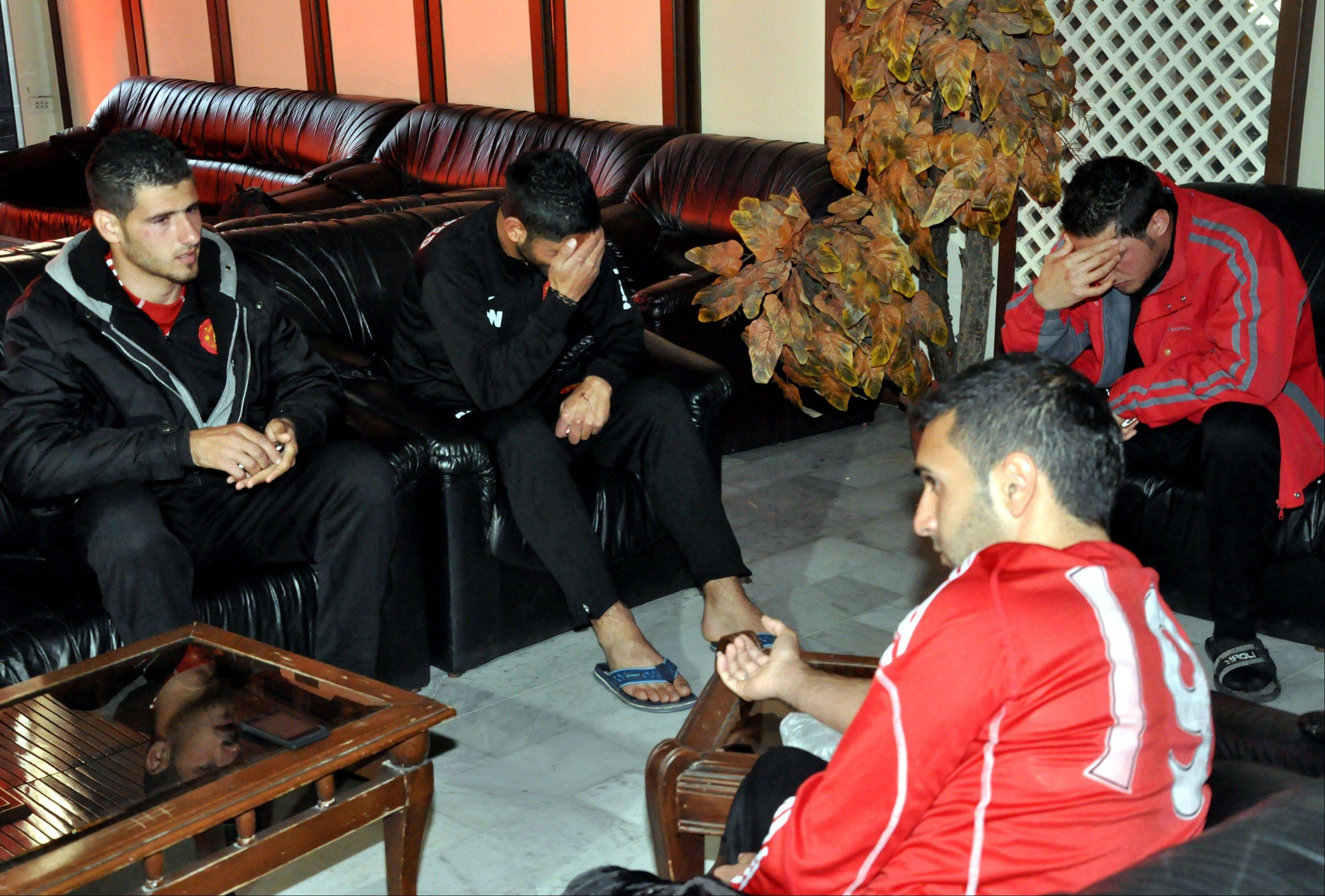 Players of the Homs-based al-Wathbah club react after two mortars exploded next to a soccer stadium in central Damascus, Syria, Wednesday, Feb. 20, 2013. Two mortars exploded killing one player and injuring several, Syria�s state-run news agency said.