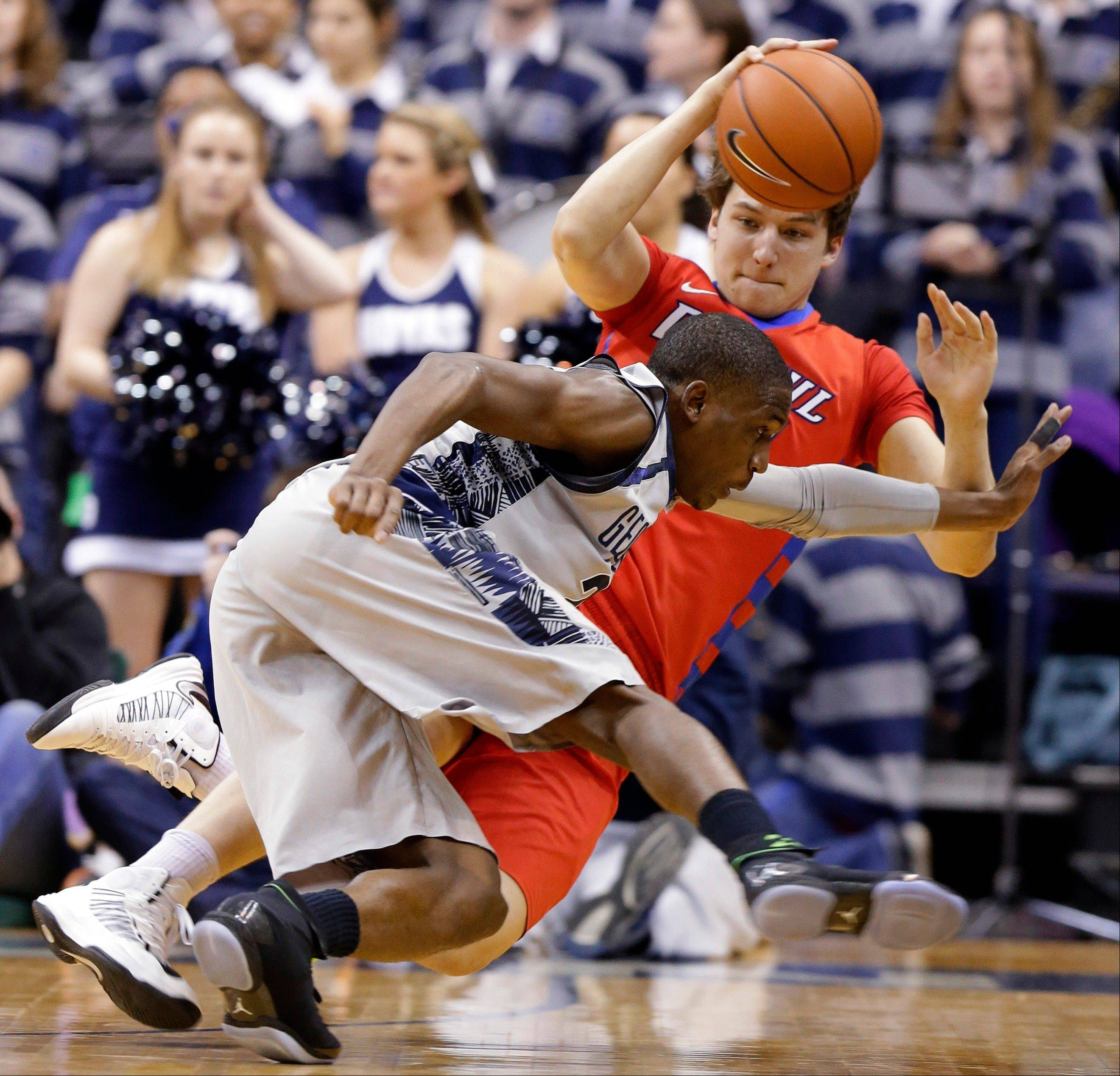 Georgetown forward Aaron Bowen, front, and DePaul forward Peter Ryckbosch scramble for a loose ball during the second half of an NCAA college basketball game, Wednesday, Feb. 20, 2013, in Washington. Georgetown won 90-66. (AP Photo/Alex Brandon)