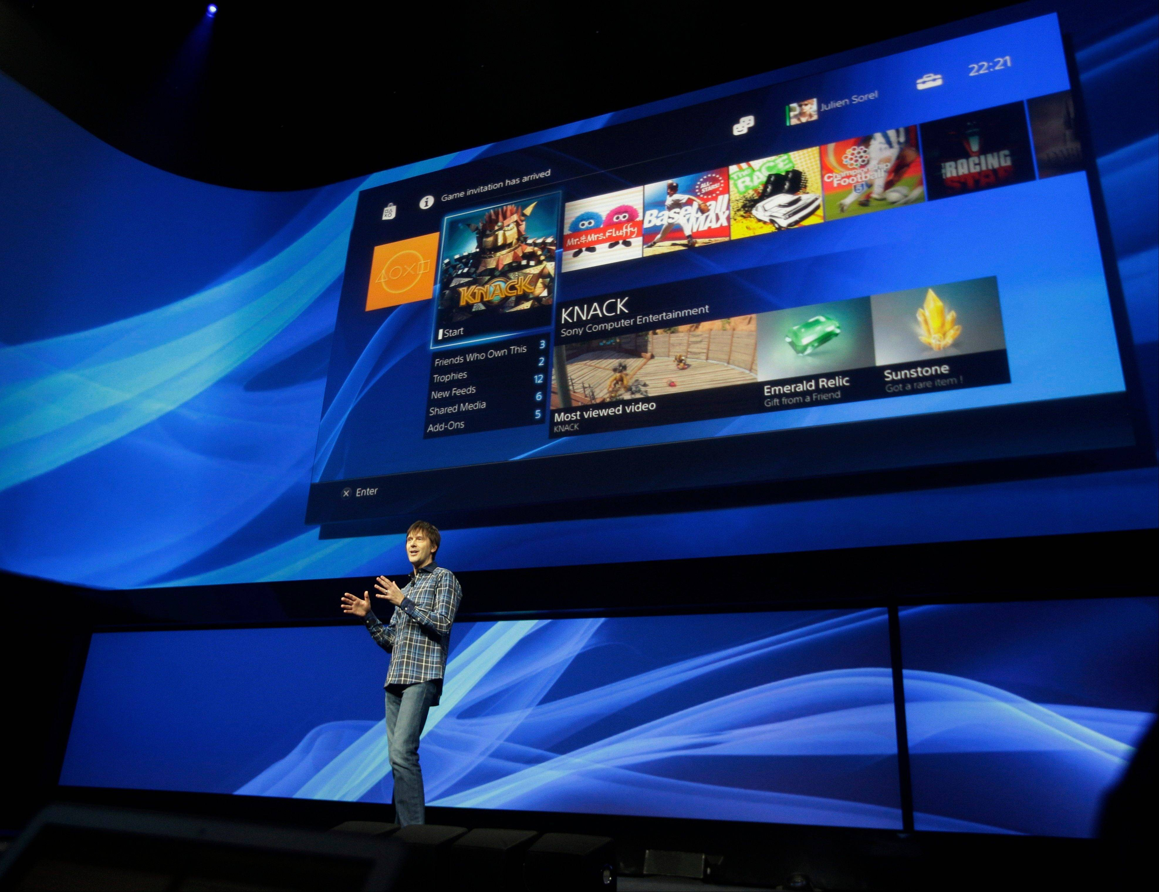 Mark Cerny, lead system architect for the Sony Playstation 4, describes the new video game console Wednesday in New York. This is Sony's first new video game console in seven years, and it introduces new cloud and social-media features.