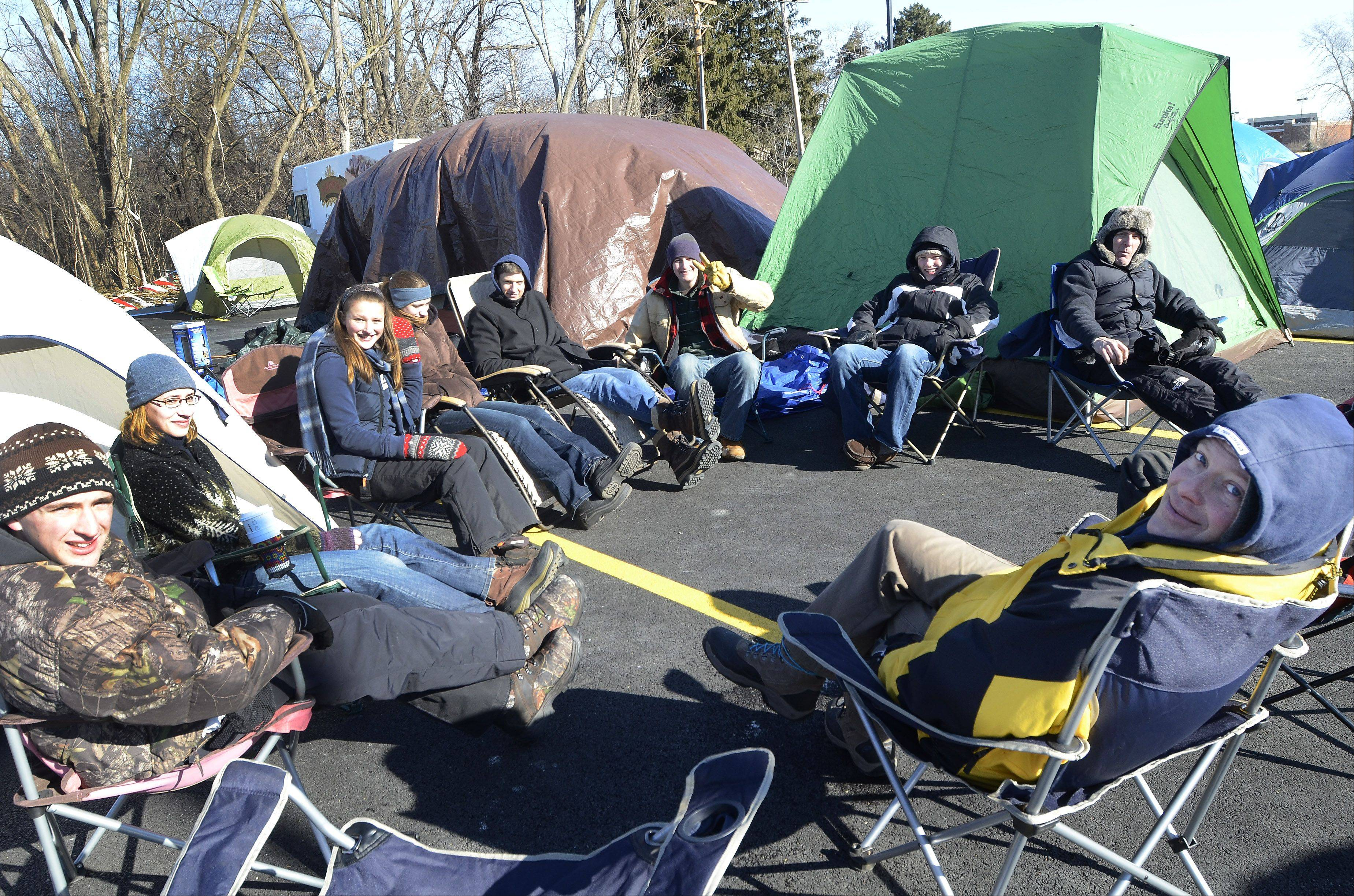 Joel Fox of Des Plaines, right, camps out Wednesday with family and friends in a tent city at the new Mount Prospect Chick-fil-A.