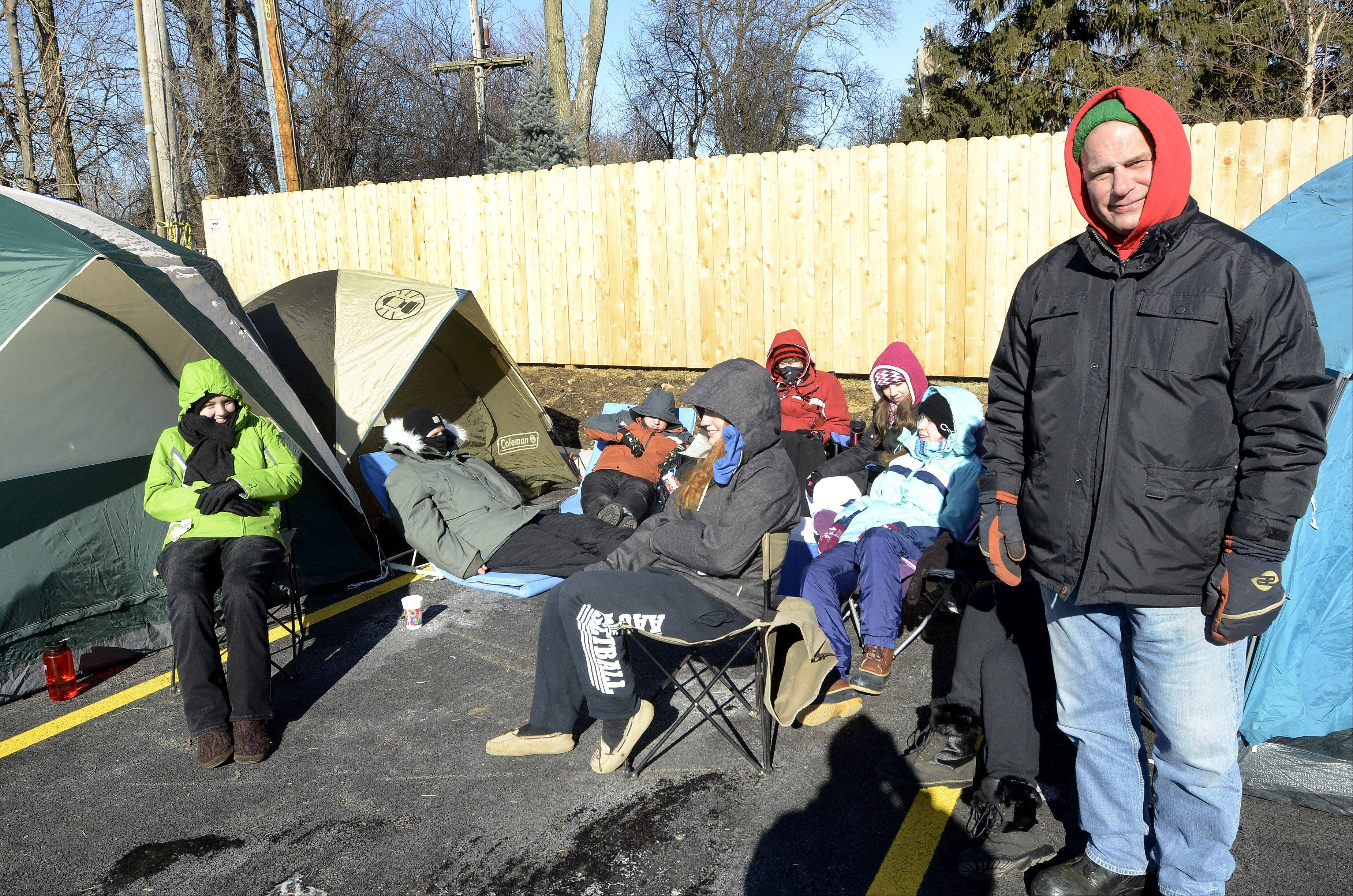 Rich Fitzgerald of Oswego camps out Wednesday with family and friends in a tent city at the new Mount Prospect Chick-fil-A.